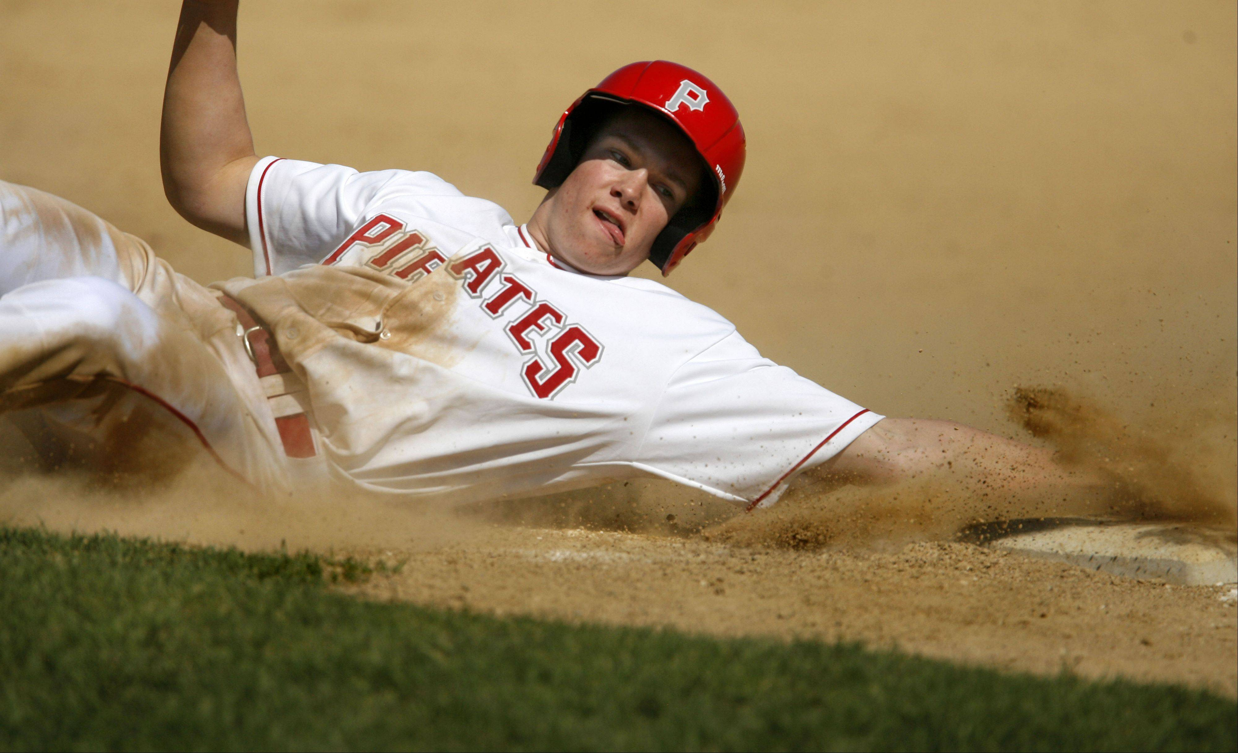 Palatine's Dan Riddle reaches in while sliding past third base during Wednesday's baseball game against Stevenson in Palatine.