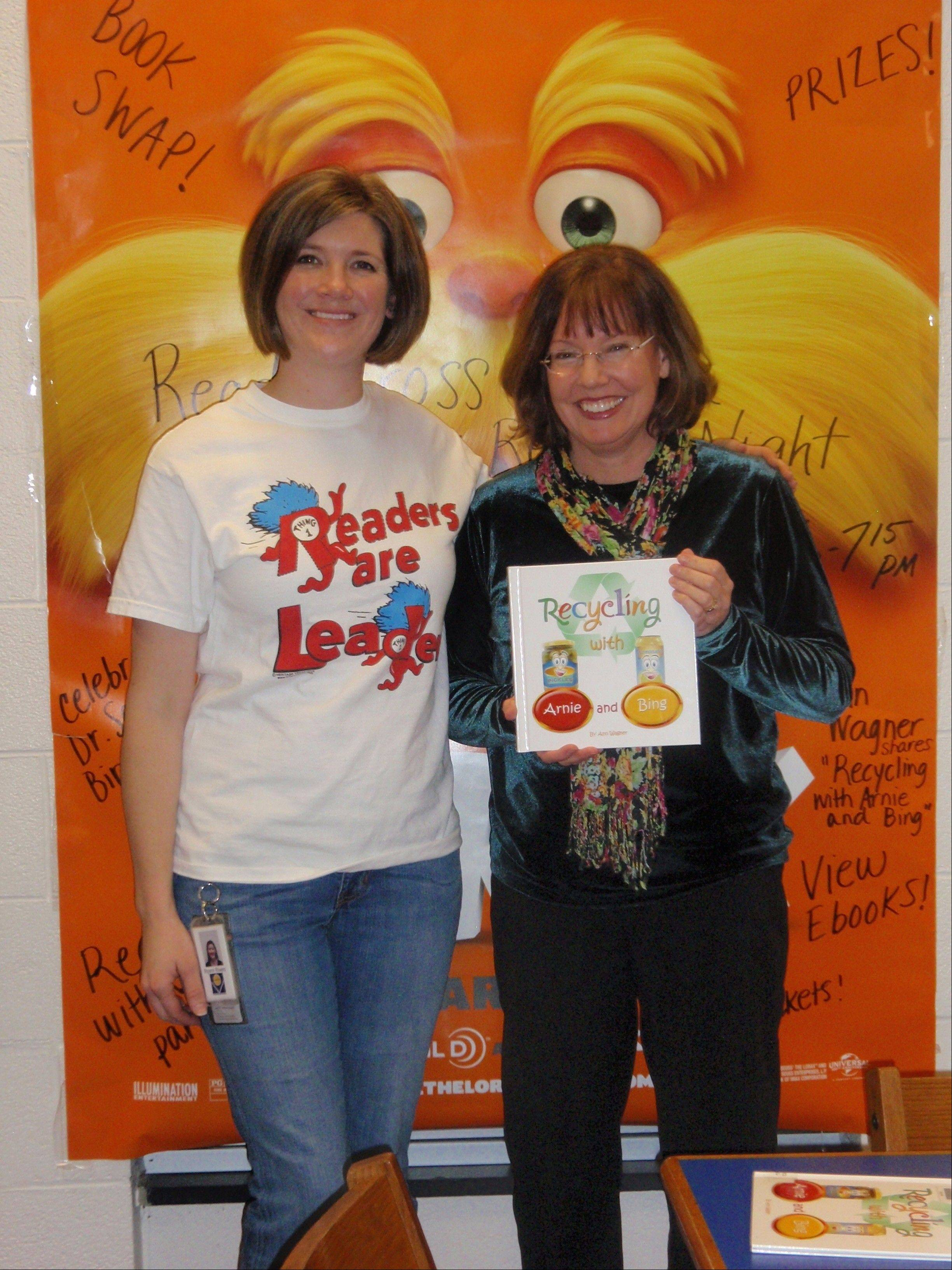 "Ryann Rivers, library media specialist and Ann Wagner, author of ""Recycling with Arnie and Bing"" at the Tarkington Family Reading Night."