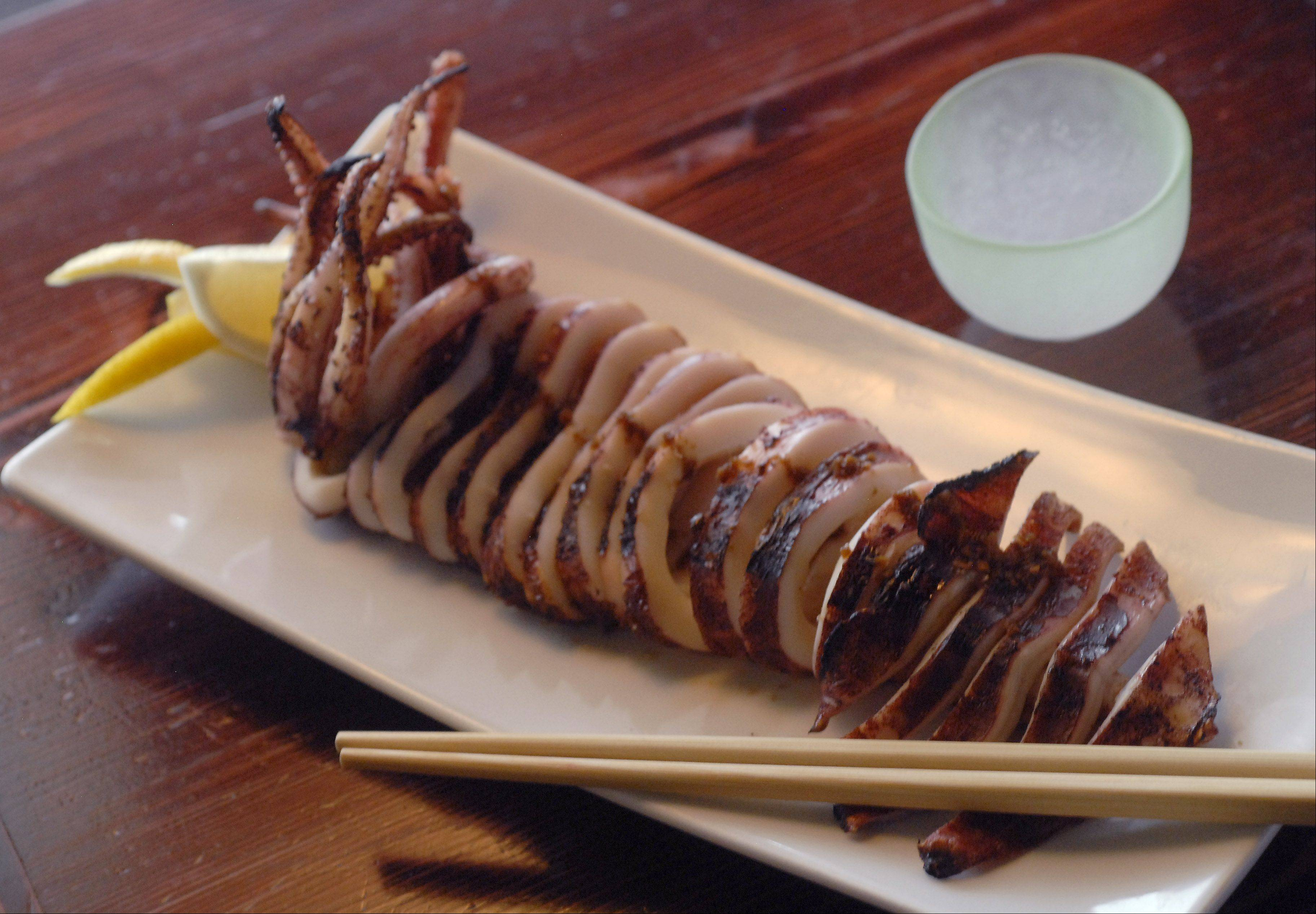 Grilled calamari is dressed in a soy ginger sauce at Bistro Dragon in Elk Grove Village.