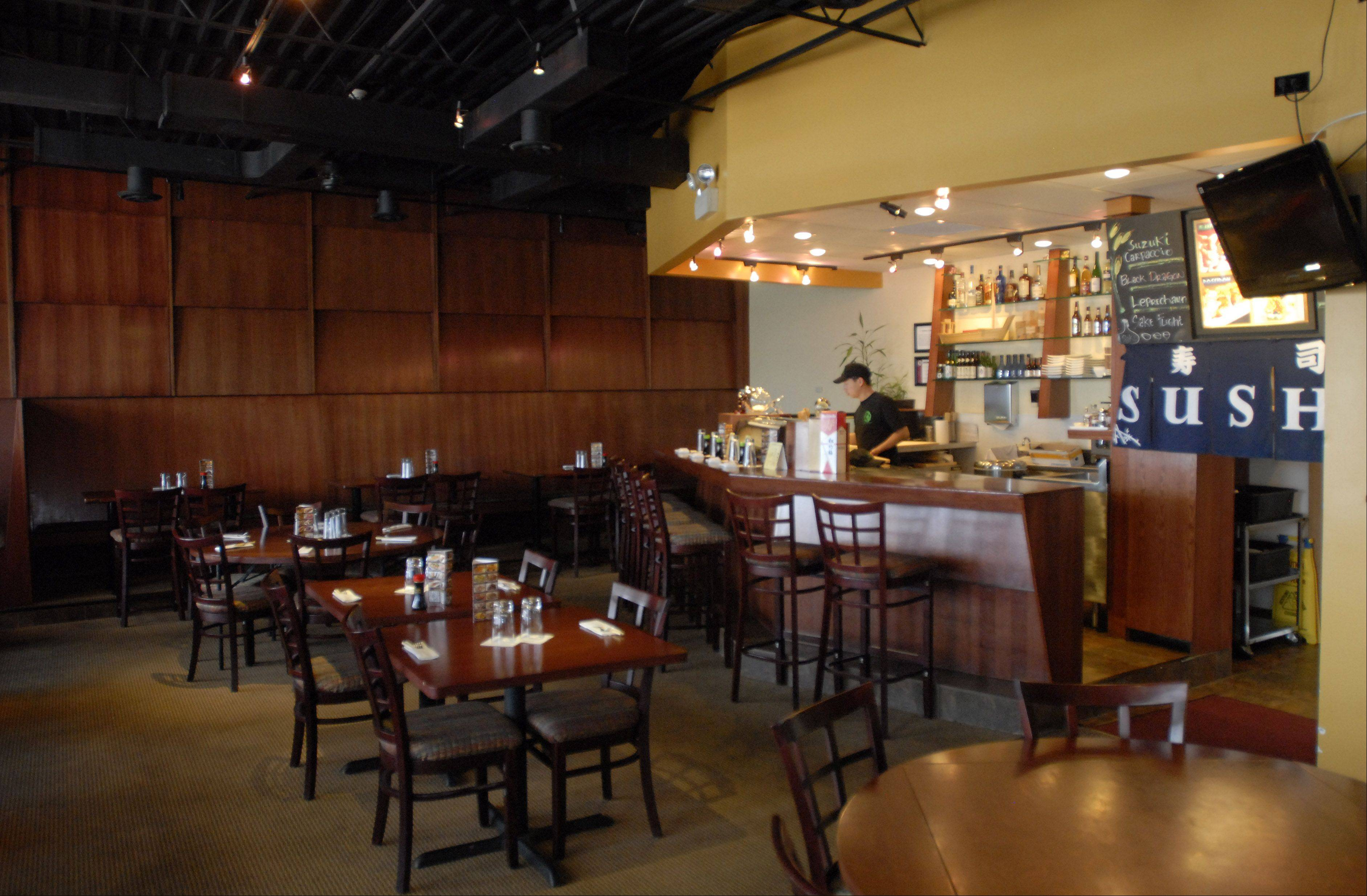 Bistro Dragon, a contemporary sushi and Chinese restaurant in Elk Grove Village, features warm wood walls and tables.