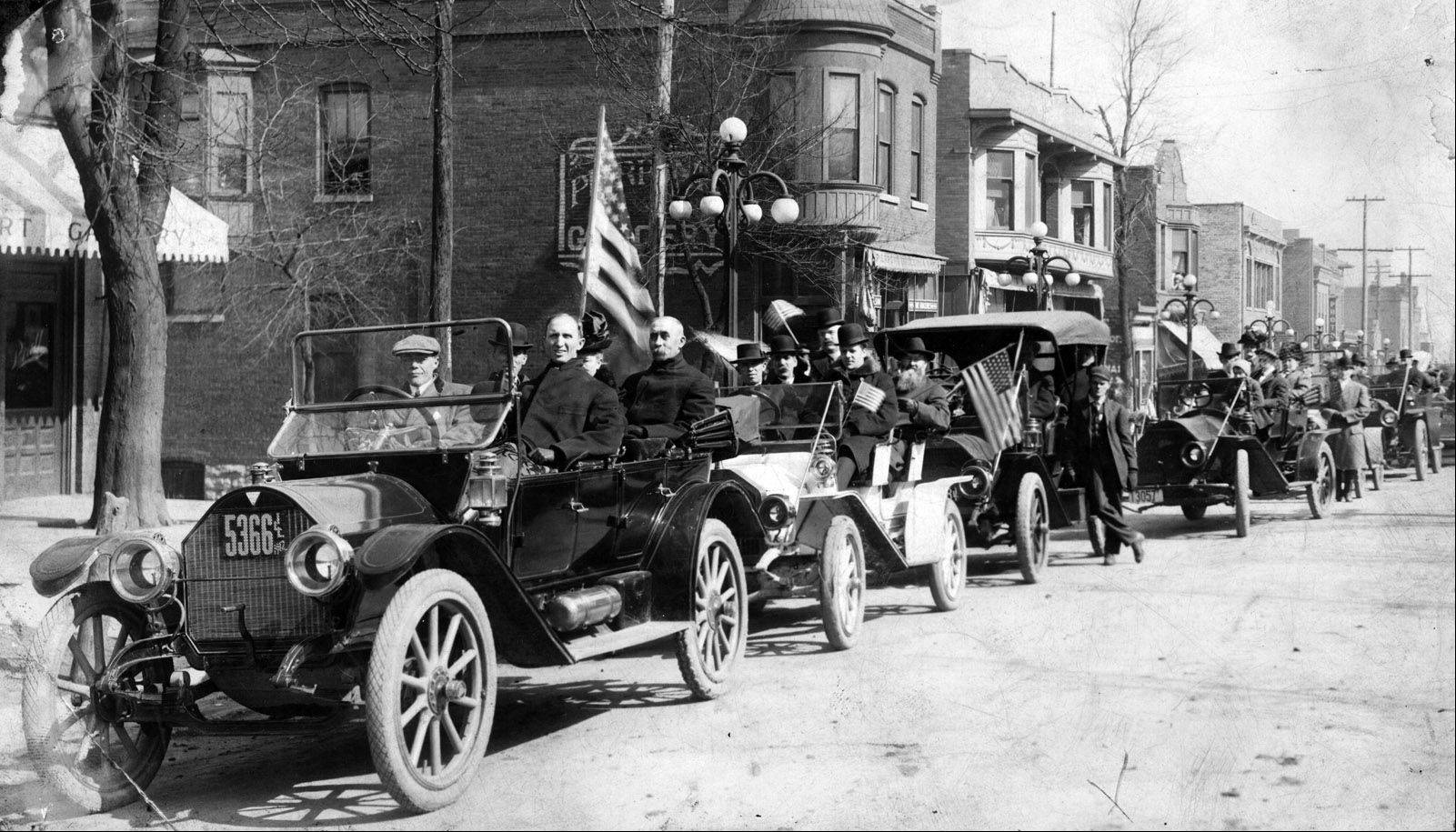 President Orrin Roe Jenks leads the Aurora College parade from the Aurora train station to the new campus on April 3, 1912. The institution was founded in Mendota in 1893 before moving to Aurora in 1912.