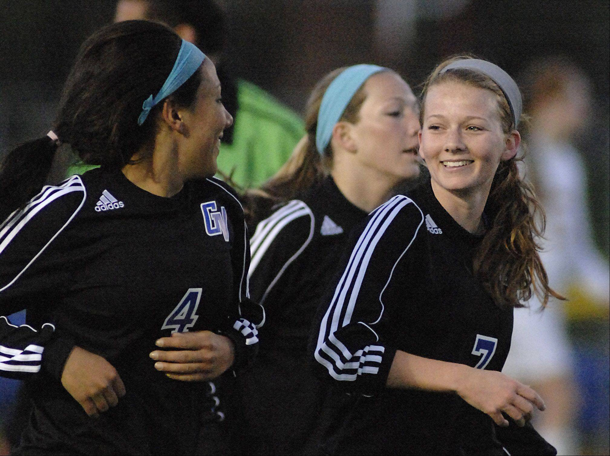Laura Stoecker/lstoecker@dailyherald.comGeneva's Hope Goodman, right, celebrates her goal in the first half with teammate Kristin Rodriguez on Wednesday, April 4.