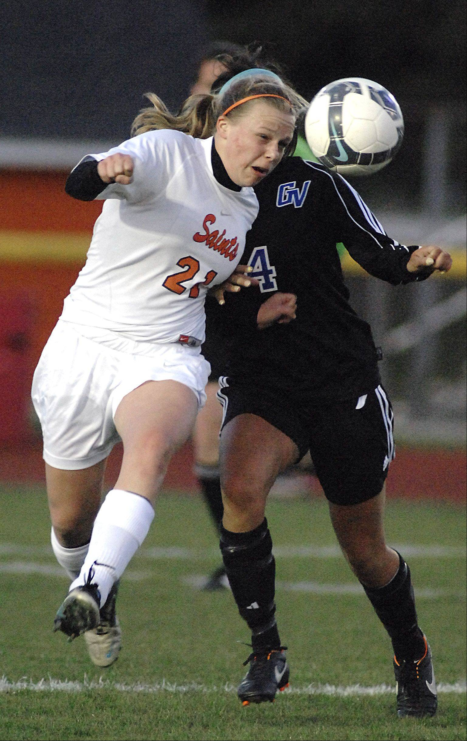 St. Charles East's Amanda Hilton heads the ball before Geneva's Kristin Rodriguez in the first half on Wednesday, April 4.