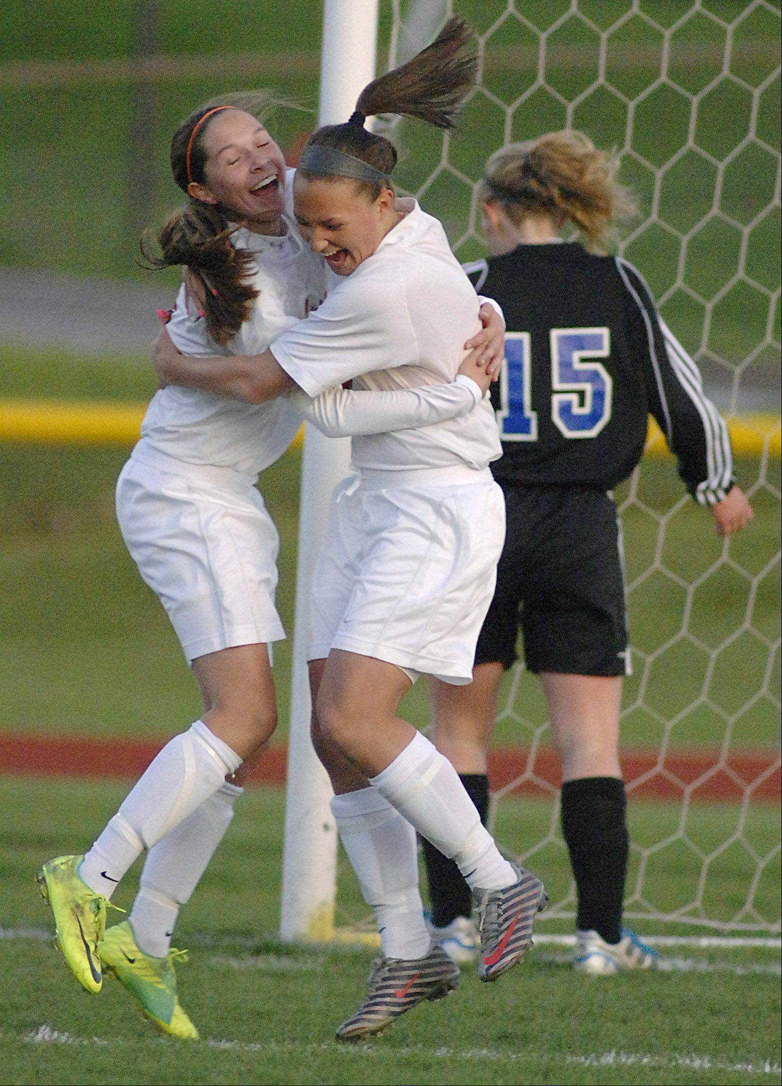 St. Charles East's Darcy Cunningham, left, celebrates her goal with teammate Carly Pottle in the first half on Wednesday, April 4.