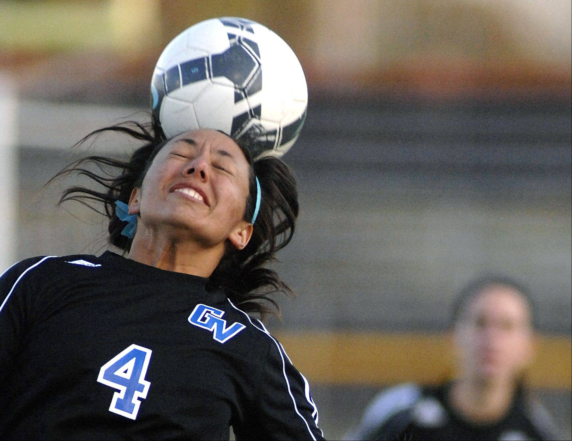 Geneva's Kristin Rodriguez heads the ball in the first half on Wednesday, April 4.