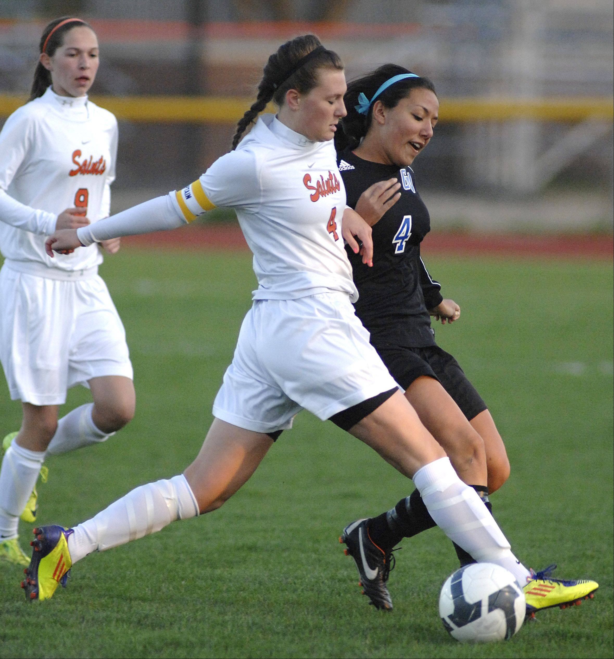 St. Charles East's Rachel Pottle and Geneva's Kristin Rodriguez battle for the ball in the first half on Wednesday, April 4.