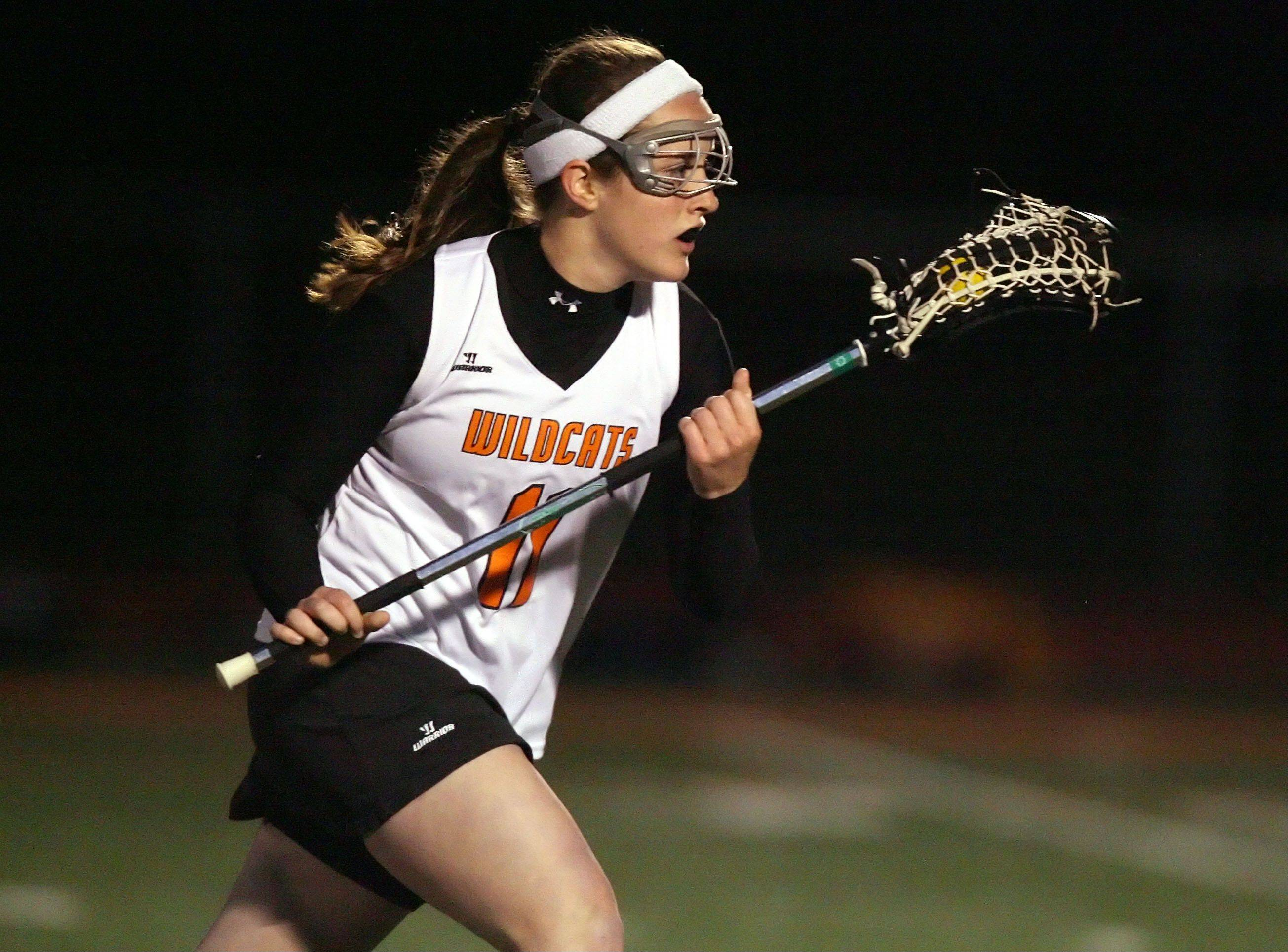 Libertyville's MK Lee drives with the ball.