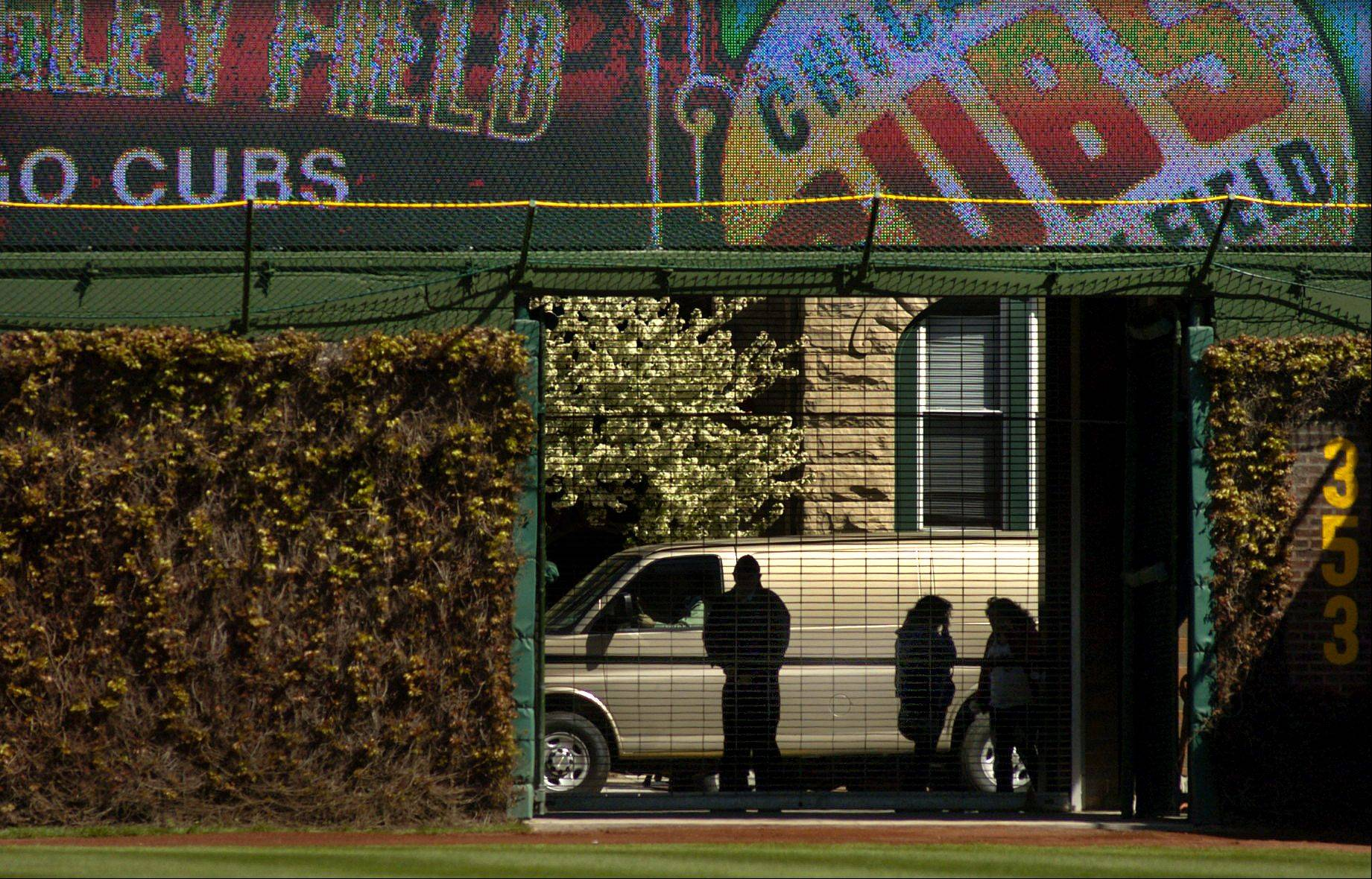 Fans look in from the right field gate .