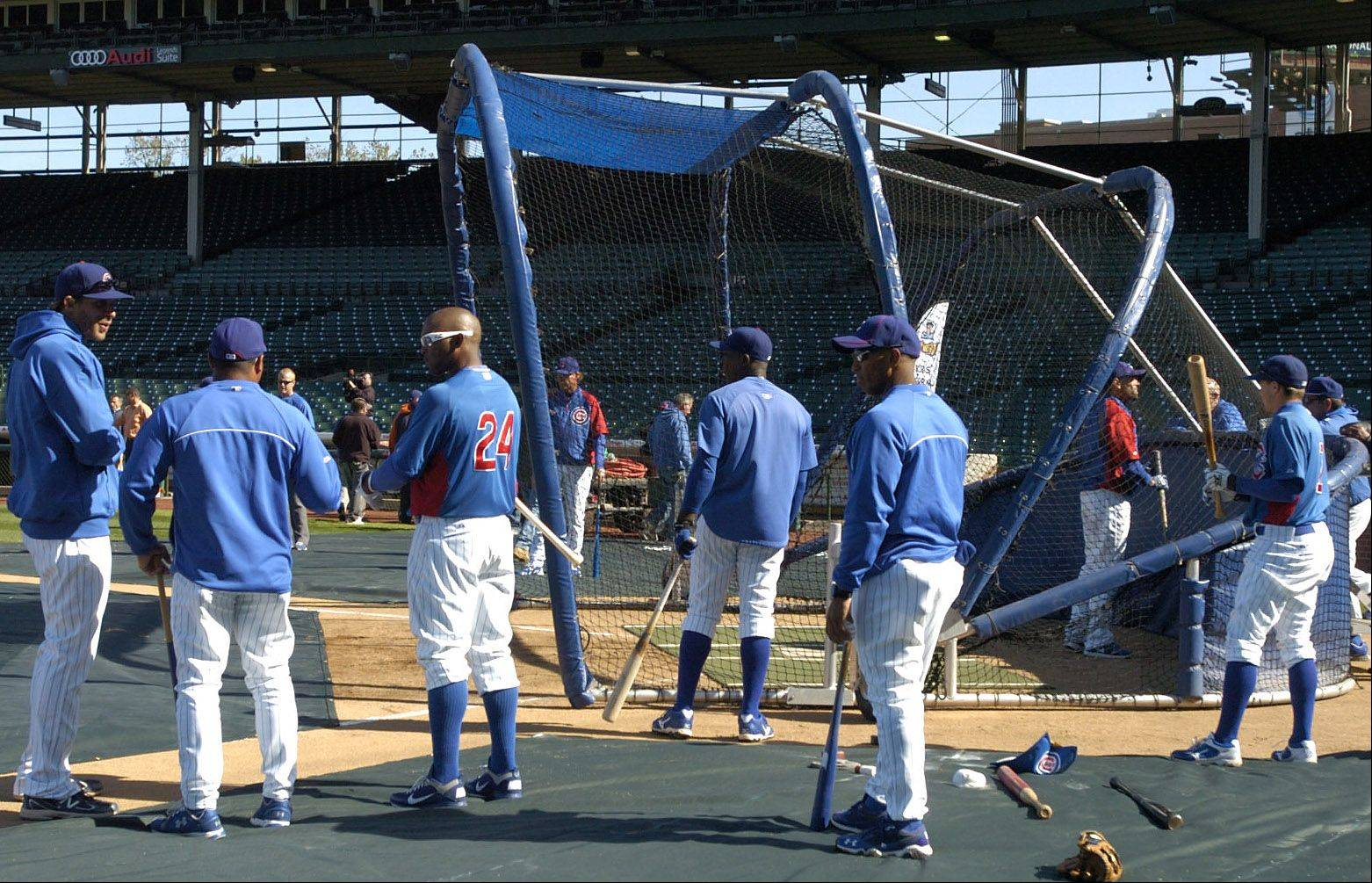 Players take batting practice.