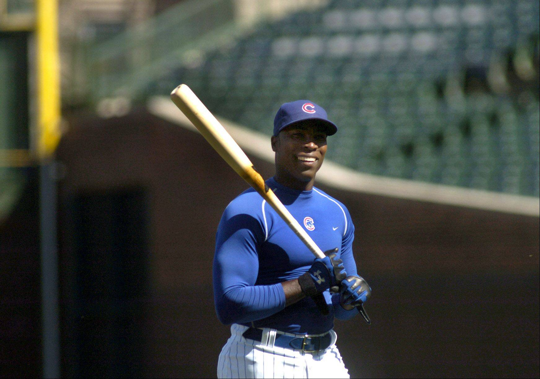 Alfonso Soriano swings a bat.