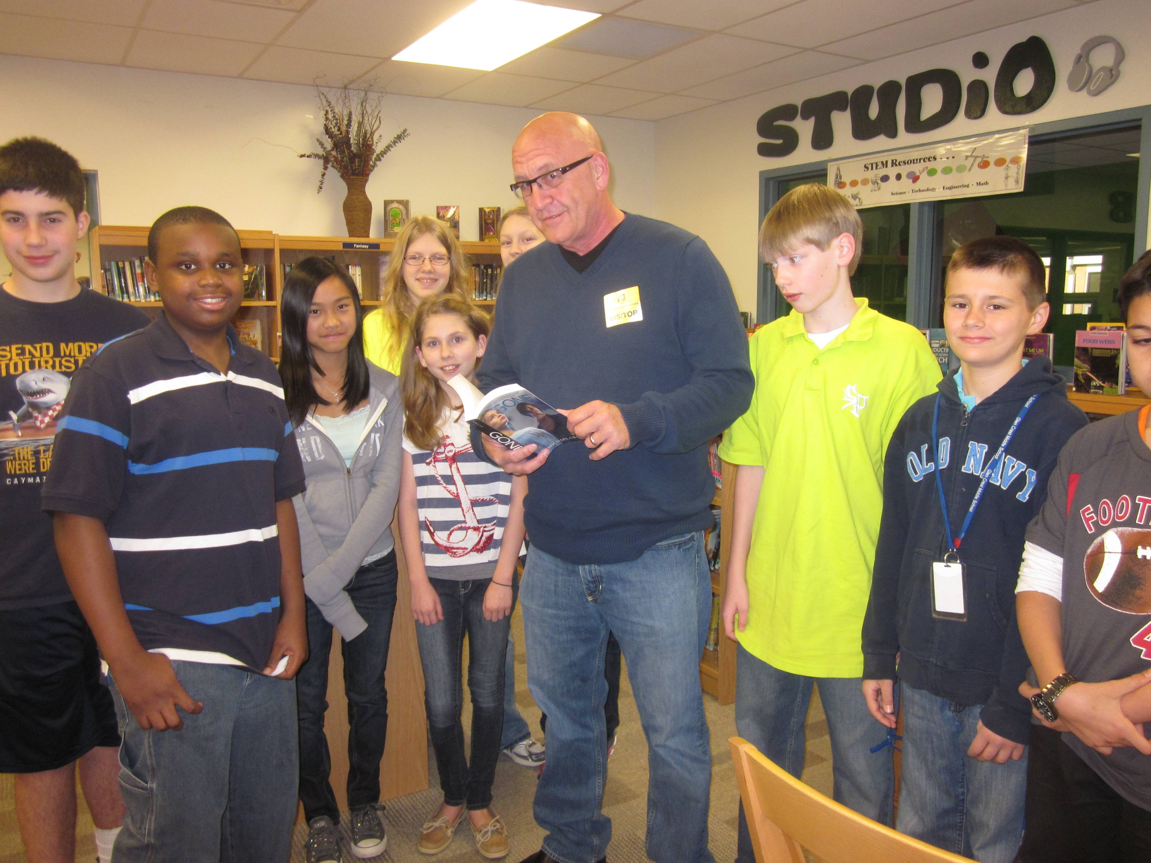 "Author Michael Grant visited with Glen Crest Middle School students on Tuesday, April 4 and discusses his very popular book series that begins with the book titled, ""Gone."""
