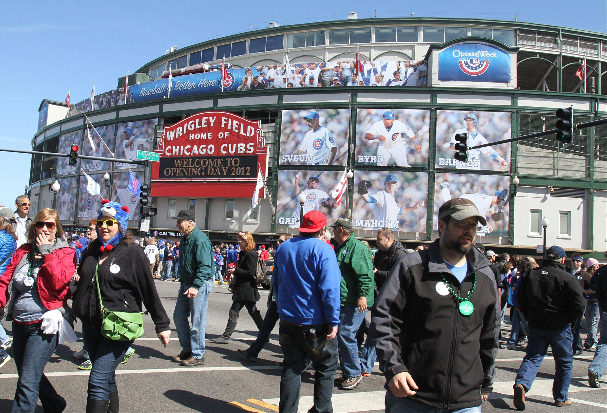 Opening Day fans had a variety of reactions to giant posters of players on the outside of their beloved Wrigley Field.
