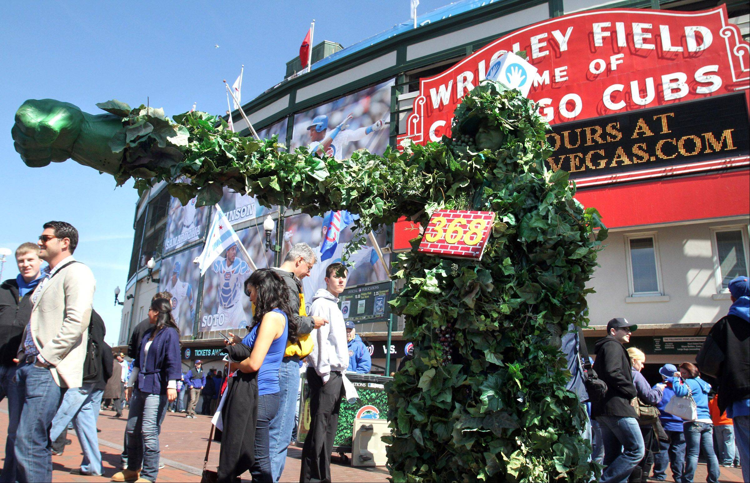 "Ward TannHauser of Crystal Lake, known as ""Ivy Man,"" packs a green punch in front of Wrigley Field Thursday."