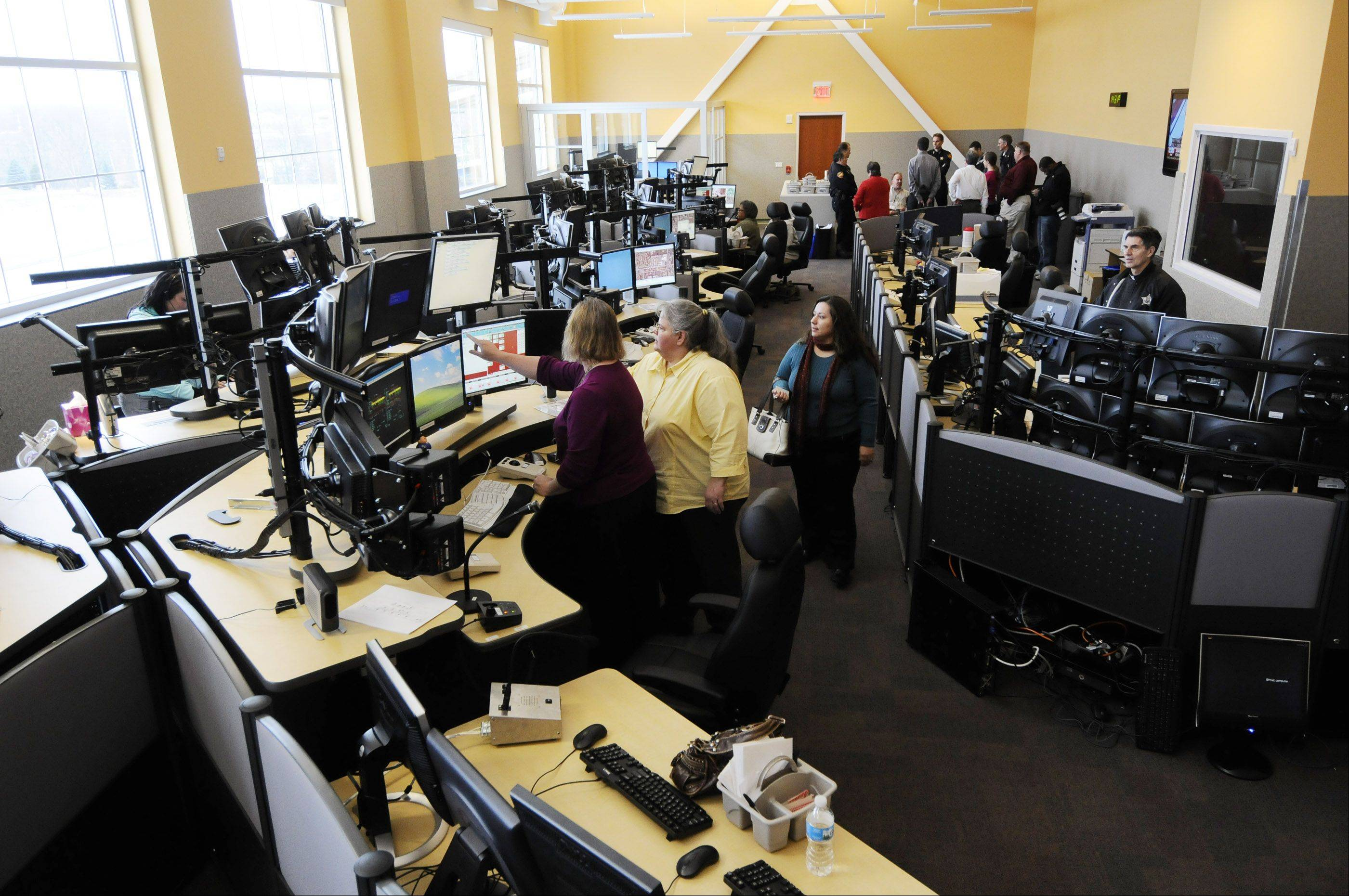 Scott Sanders/ssanders@dailyherald.com � An overall view of Aurora's new 911 dispatch center for police and fire which is about four times the size of the old dispatch center and more highly computerized, dispatchers said.