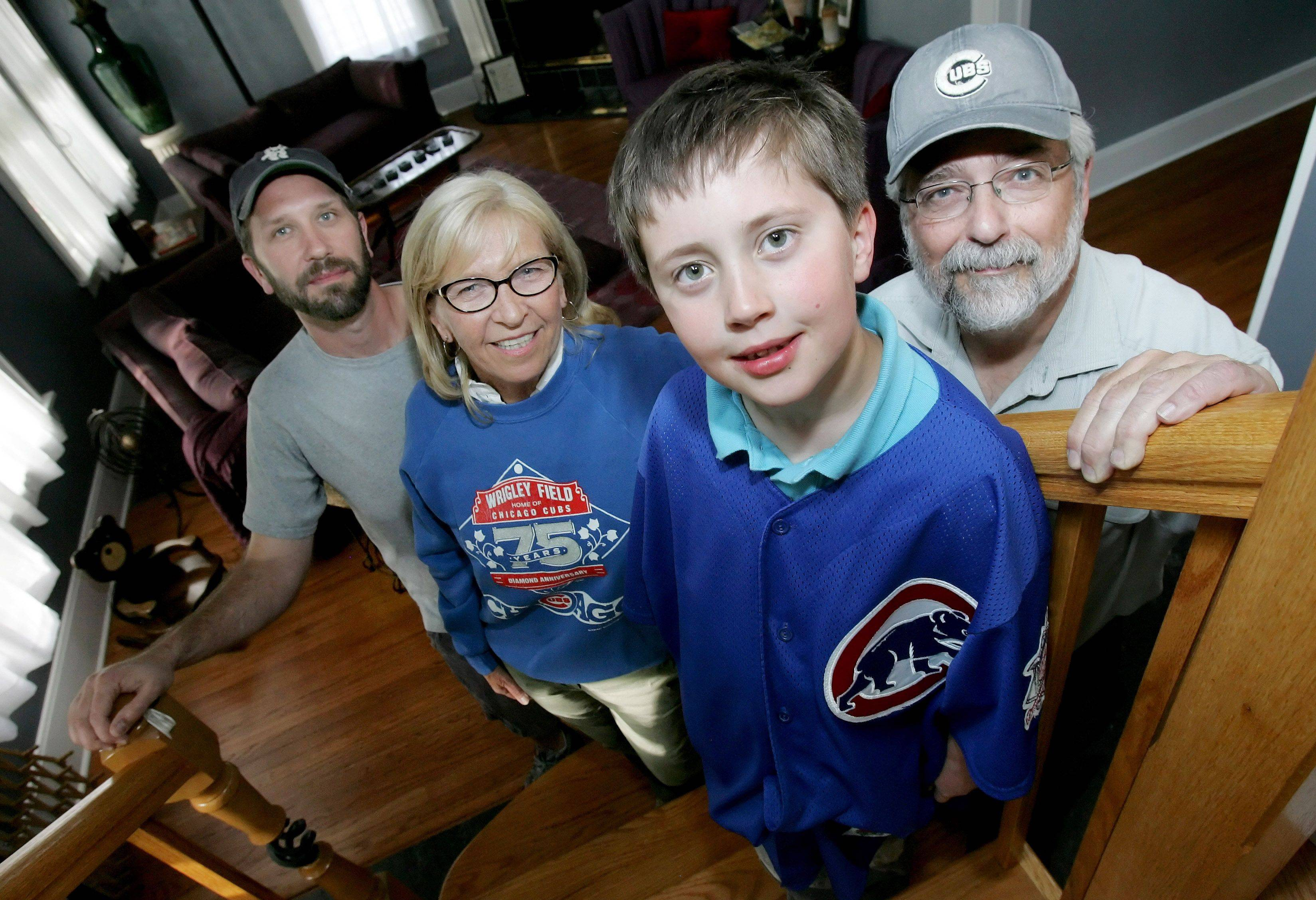 Opening Day at Wrigley Field is a holiday at the Hruby household in Wheaton. Matriarch Debra and her son Sean, left, of Geneva, will be attending their 28th consecutive Cubs' opener today. Sean's dad Mike, right, has been to about half of those, while Sean's son Cal, 7, is joining the clan for the third straight year.