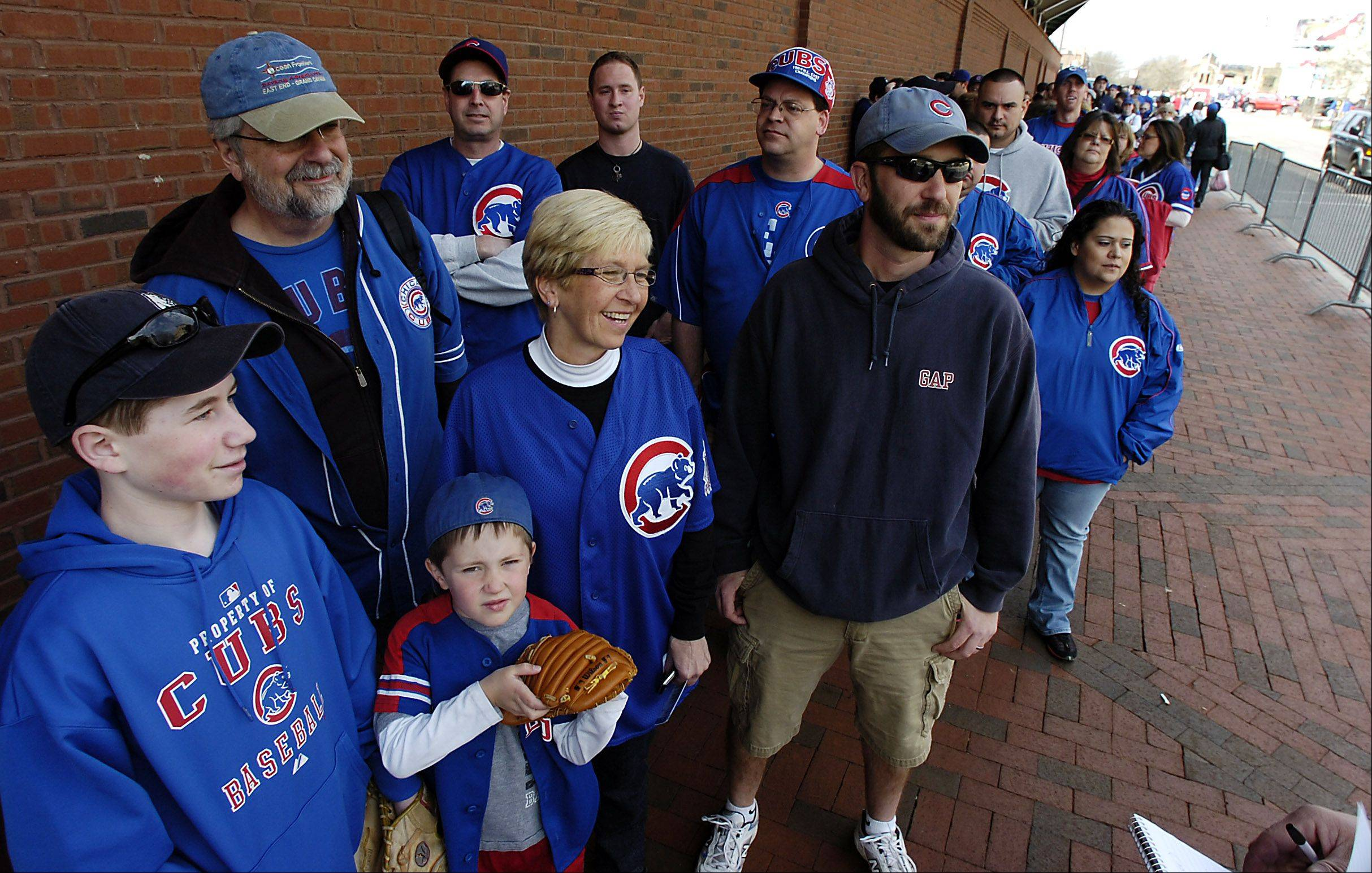 Waiting in line for the usual bleacher seats on Opening Day 2010, friend Kevin Riemer, 14, left, of Wheaton, hangs with Mike and Debra Hruby, their son, Sean, right of Geneva, and Sean's 5-year-old son, Cal. All three generations of the Hruby family will be at today's opener at Wrigley Field, which marks the 28th consecutive year for Debra and Sean.