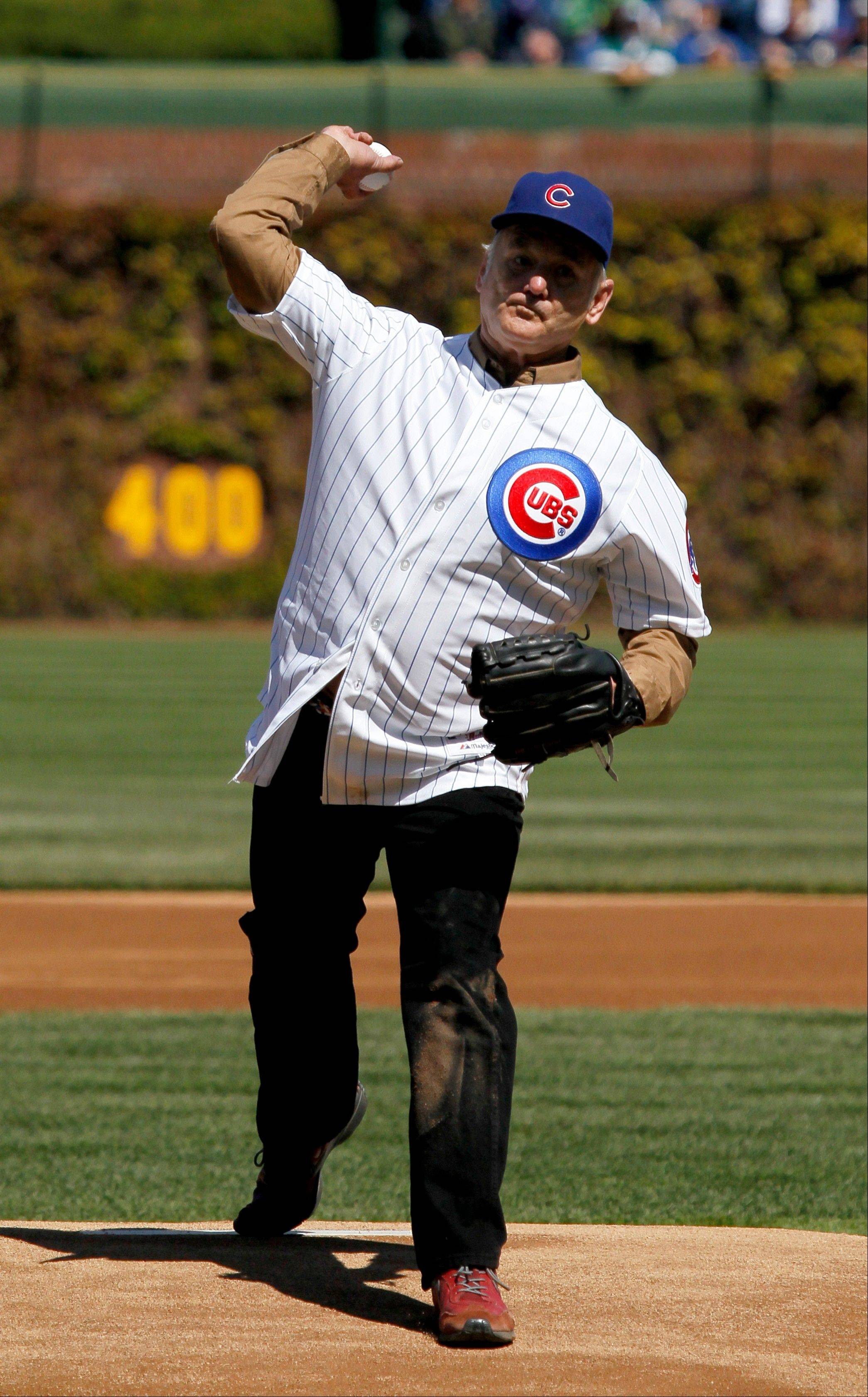 Actor Bill Murray throws out a ceremonial first pitch before an opening day baseball game between the Chicago Cubs and the Washington Nationals Thursday, April 5, 2012, in Chicago. The Nationals won 2-1.