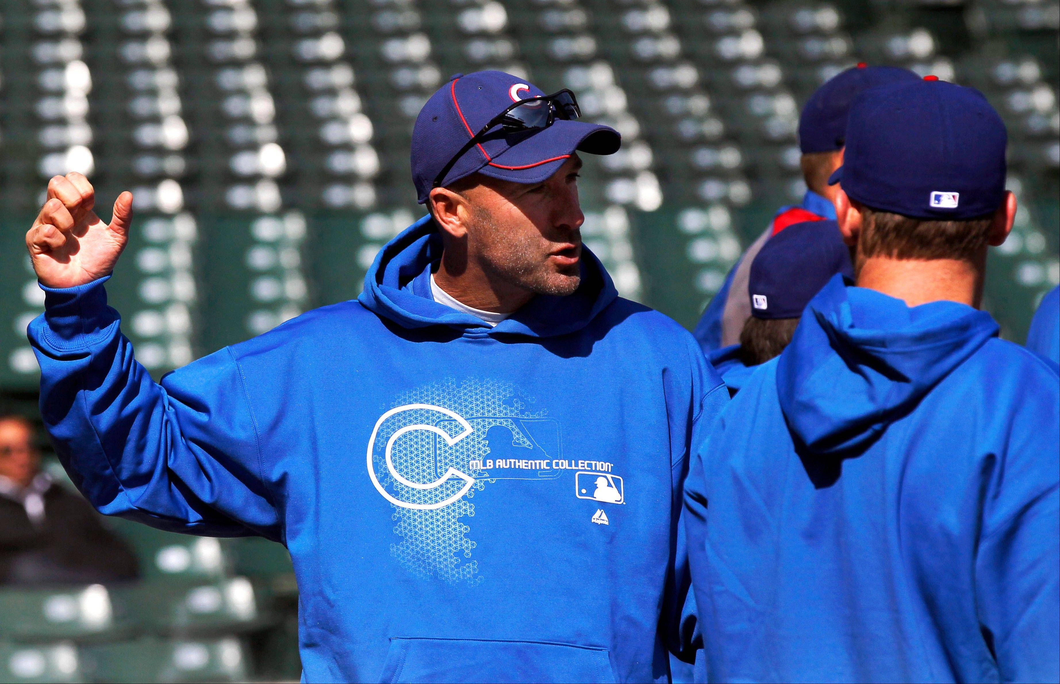 Chicago Cubs manager Dale Sveum, left, talks with starting pitcher Ryan Dempster before an opening day baseball game against the Washington Nationals, Thursday, April 5, 2012, in Chicago.