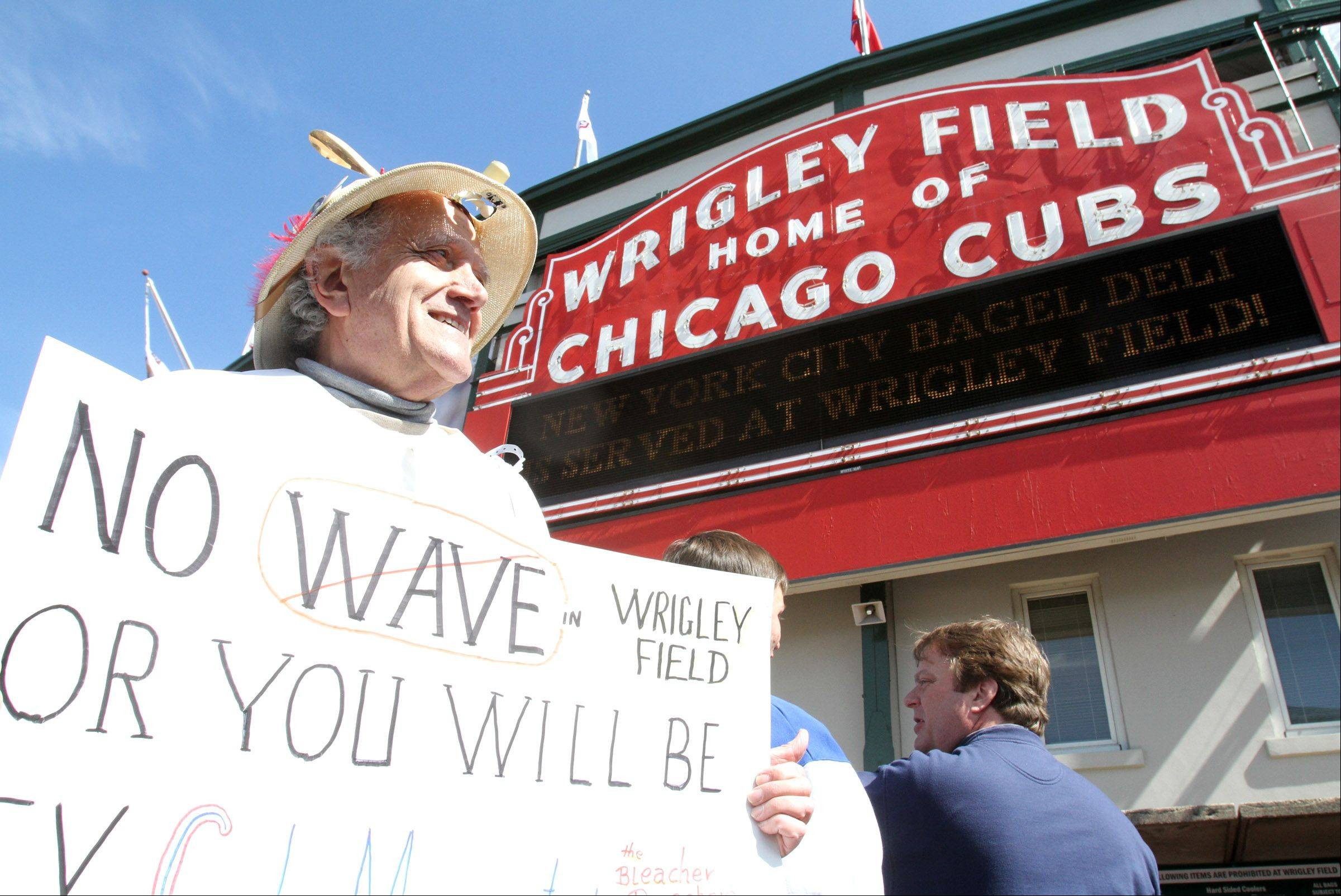 "Jerry Pritikin of Morton Grove ""The Bleacher Preacher"" appears outside Wrigley Field before the home opener against Washington."