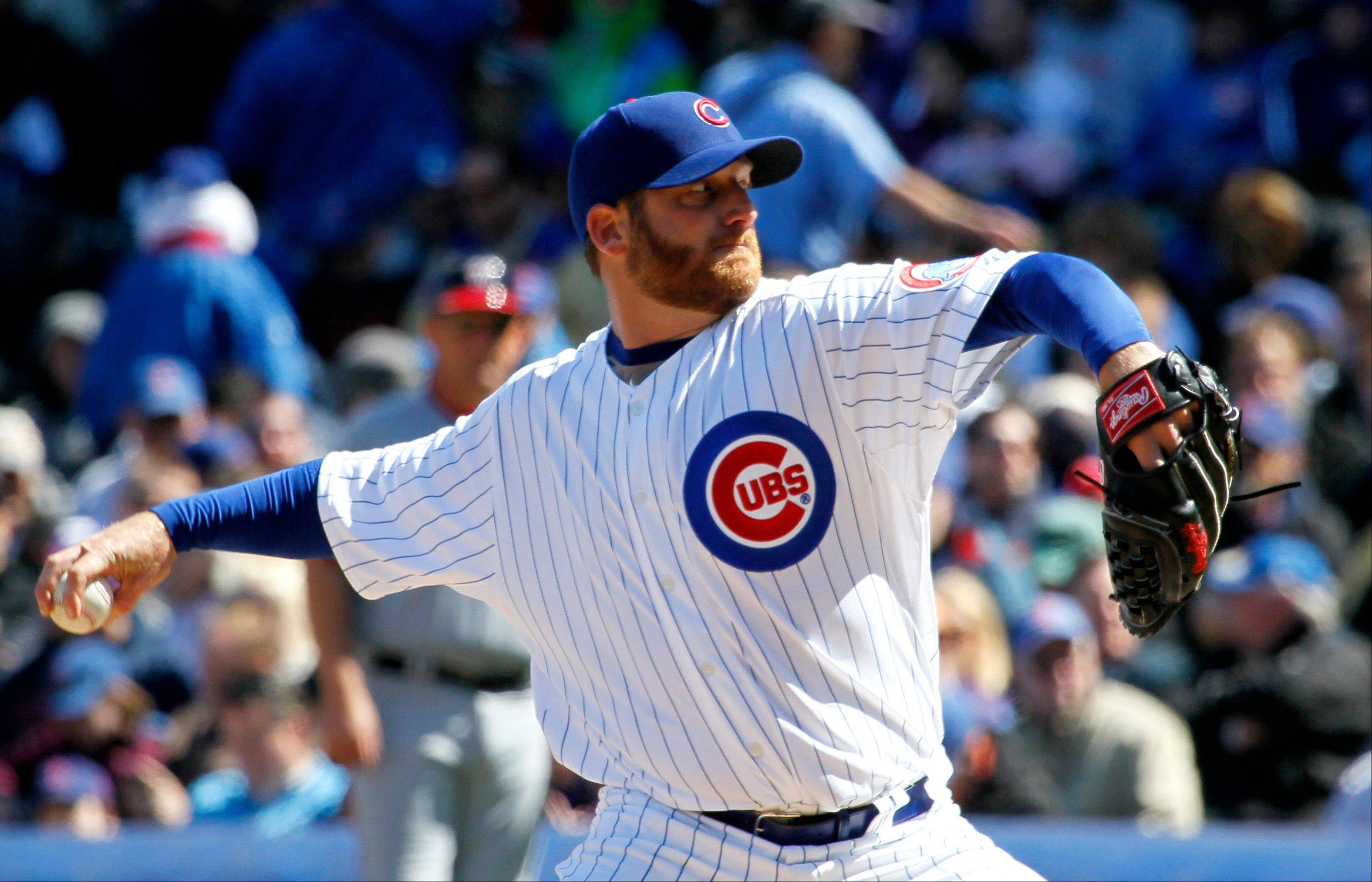 Chicago Cubs starting pitcher Ryan Dempster delivers during the second inning of an opening day baseball game against the Washington Nationals, Thursday, April 5, 2012, in Chicago.