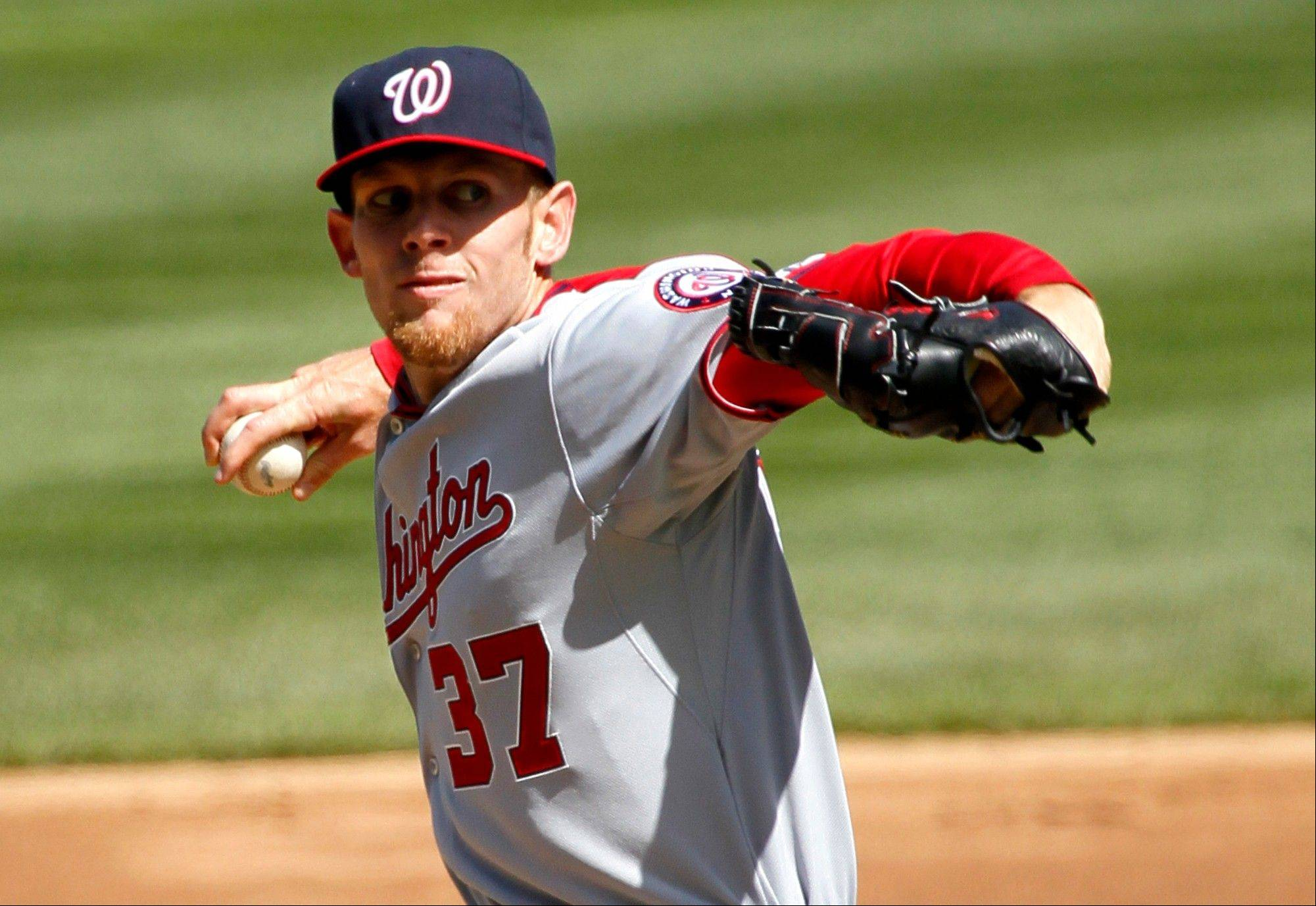 Washington Nationals starting pitcher Stephen Strasburg delivers during the second inning of an opening day baseball game against the Chicago Cubs, Thursday, April 5, 2012, in Chicago.