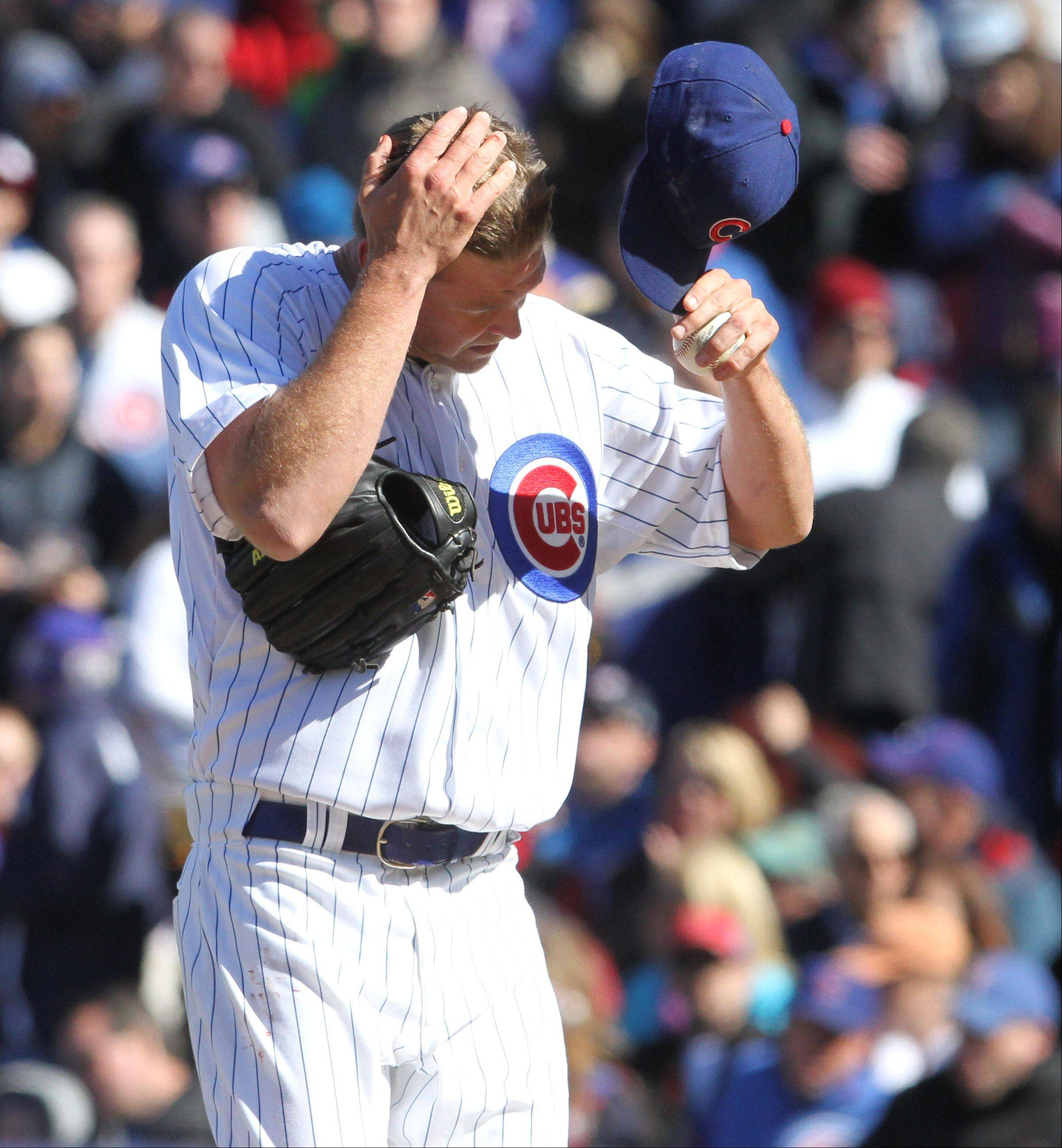 Chicago Cubs relief pitcher Kerry Wood wipes his forehead.