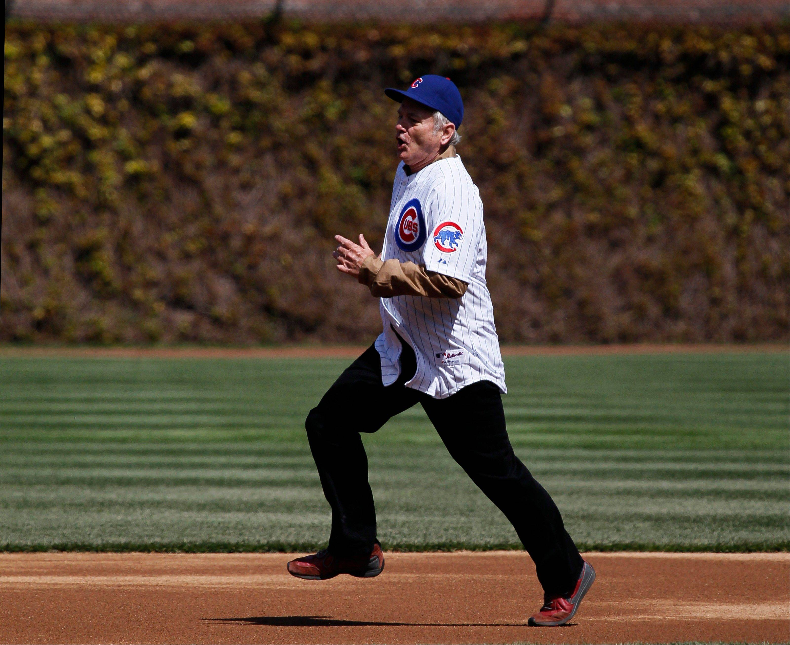 Actor Bill Murray rounds the bases before throwing out the ceremonial first pitch before a opening day baseball game between the Chicago Cubs and the Washington Nationals Thursday, April 5, 2012, in Chicago. The Nationals won 2-1.