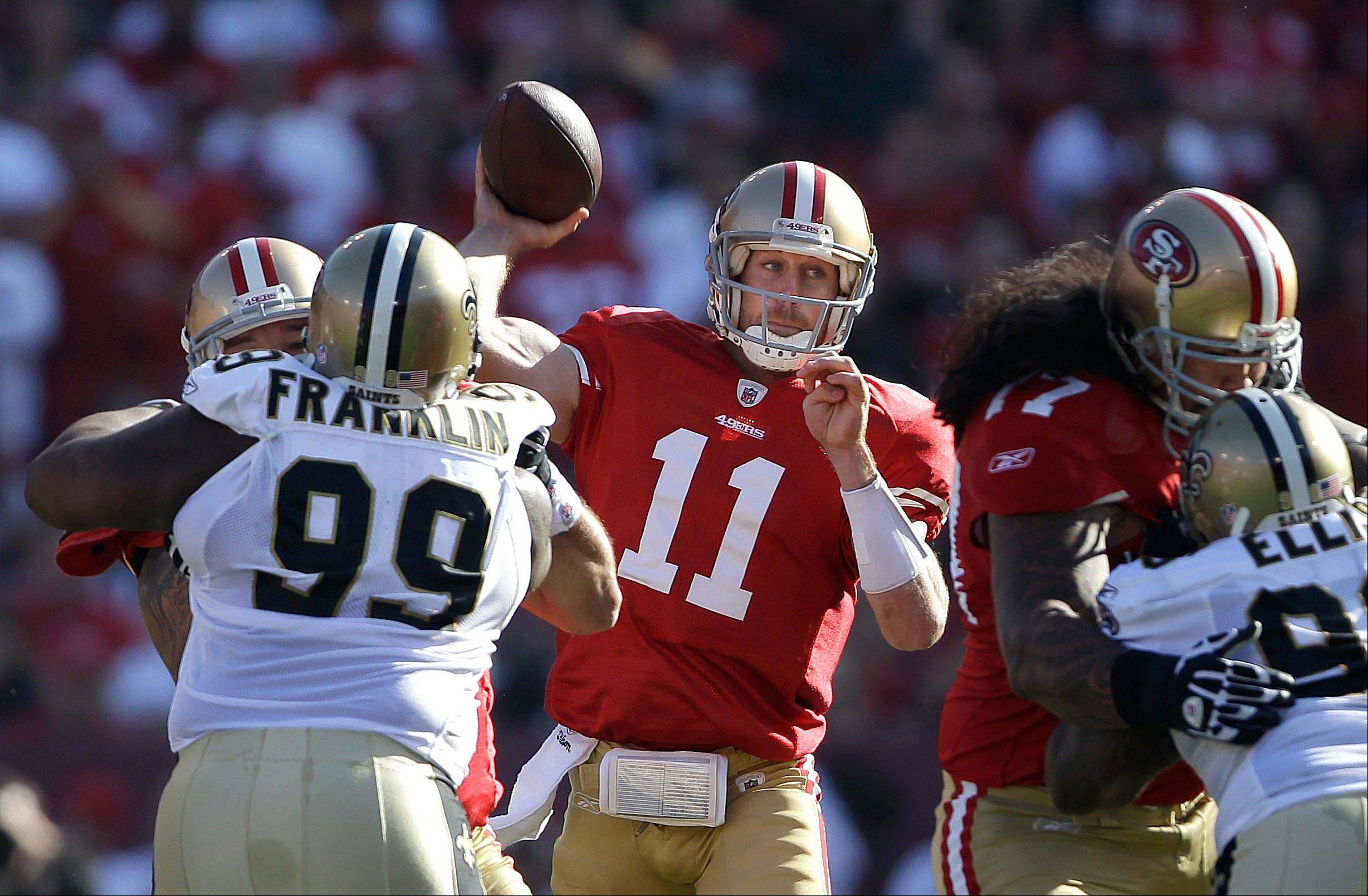 "San Francisco 49ers quarterback Alex Smith passes against the New Orleans Saints during the second quarter of an NFL divisional playoff football game. A newly released recording purports to capture former Saints defensive coordinator Gregg Williams urging players to beat running back Frank Gore's head, ""lay out"" quarterback Alex Smith and go after receiver Michael Crabtree's knee."