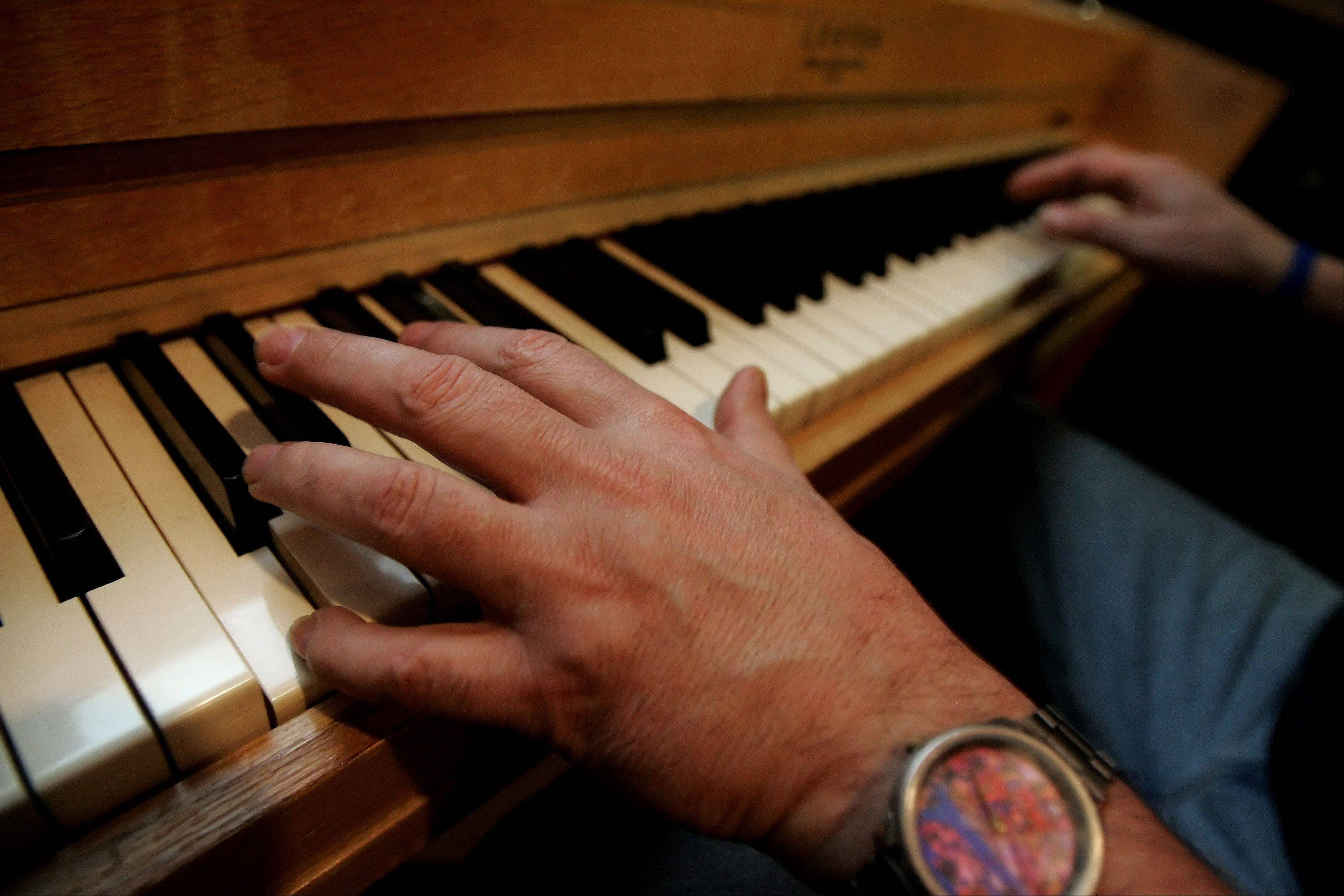 "Barrelhouse Chuck Goering plays ""Barrelhouse Woman"" on the piano in his Libertyville basement. He's played piano with blues greats B.B. King, Bo Diddley and Buddy Guy."