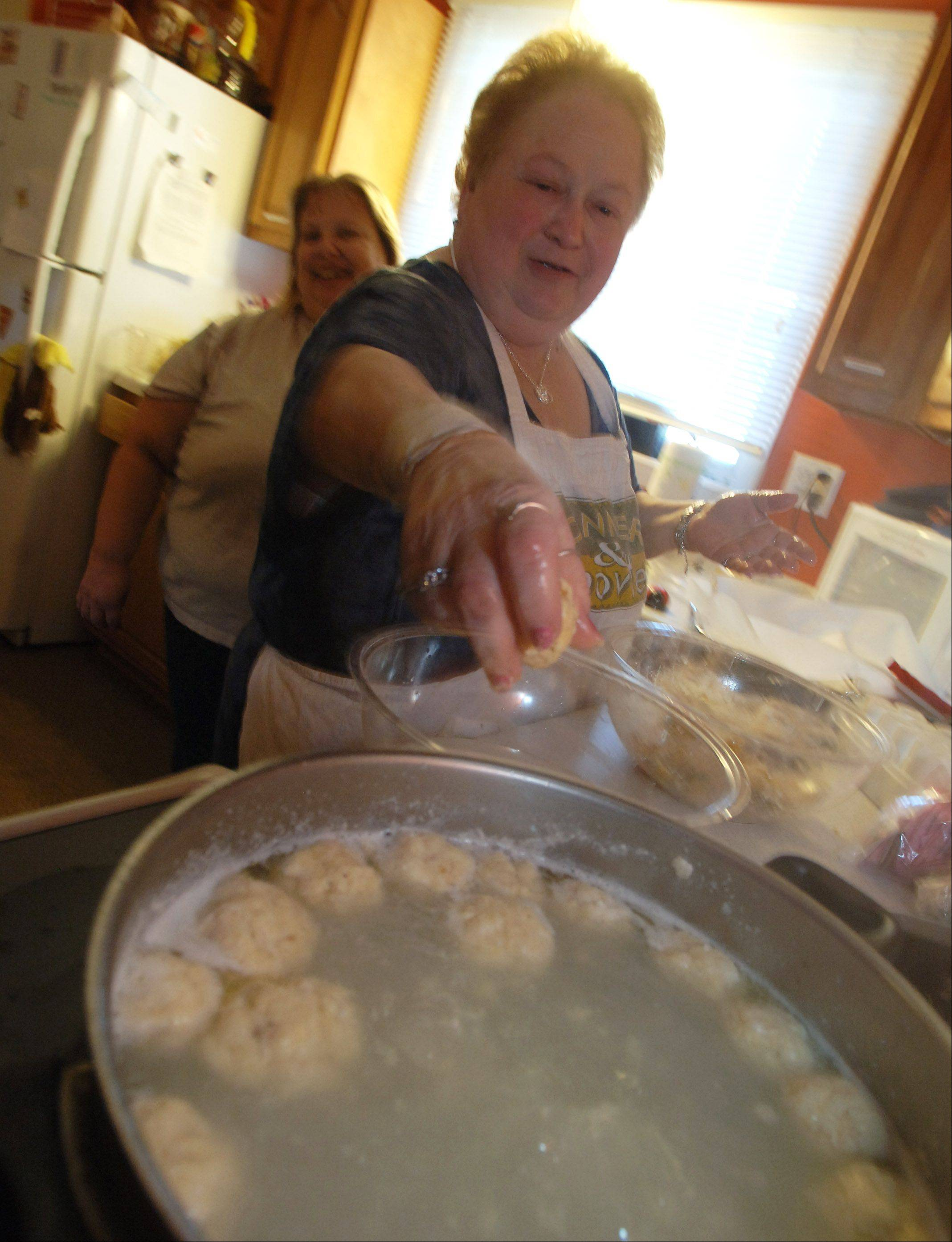 Nancy Hohs, left, of Round Lake Beach and Leah Greenberg of Gurnee prepare matzo ball soup Friday at Congregation Or Tikvah in Grayslake. The congregation is holding their Passover Seder meal Saturday evening for around 50 people.