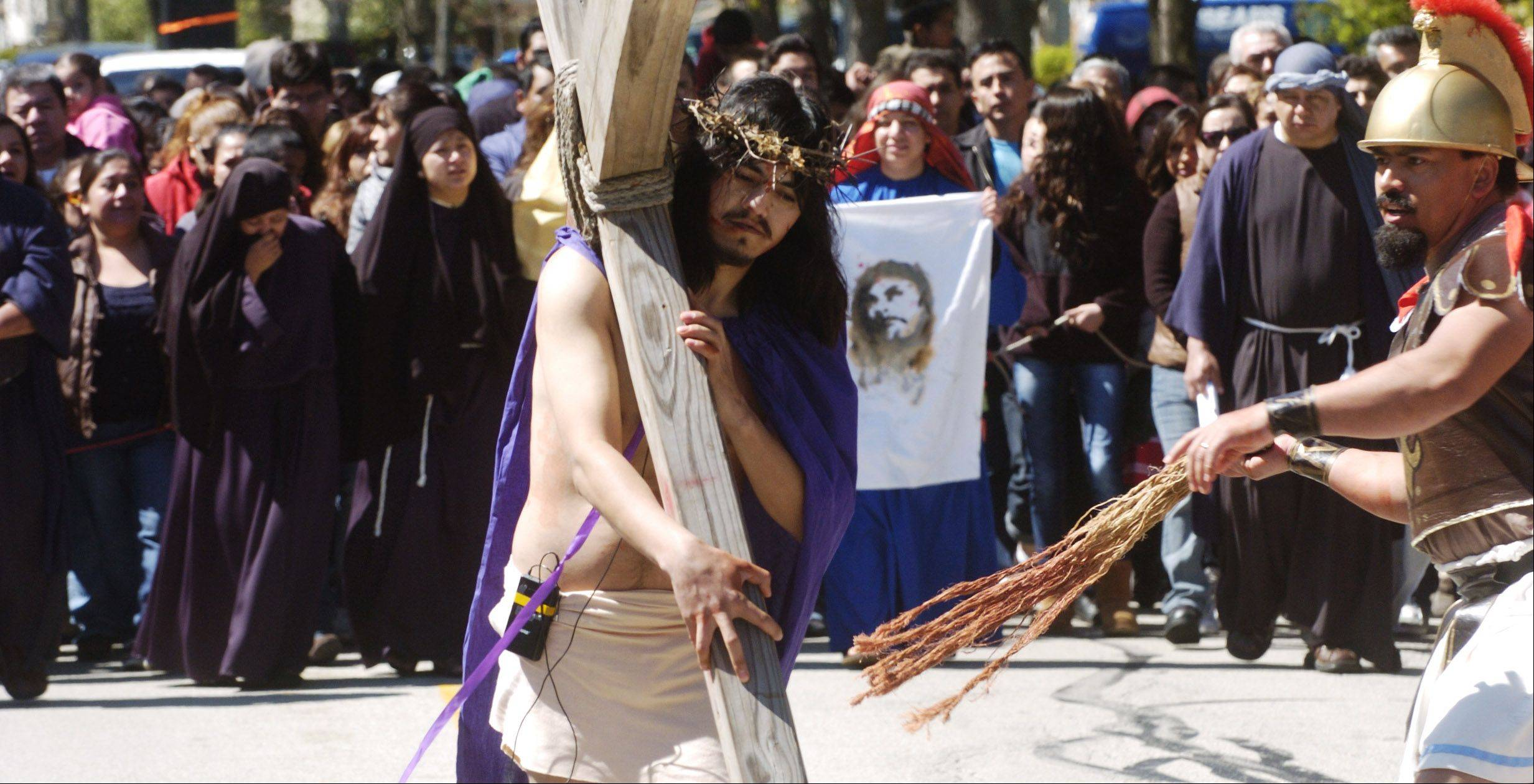 Jesus, played by Martin Carrera, carries his cross during the live Way of the Cross procession between St. Thomas of Villanova in Palatine and Mission San Juan Diego in Arlington Heights on Good Friday.
