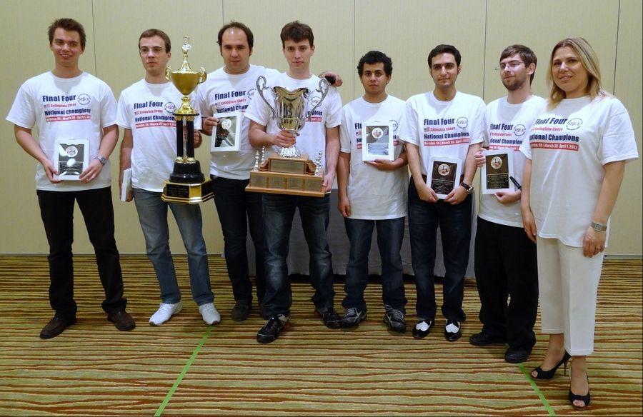 Texas Tech University coach Susan Polgar, right, and the Knight Raiders chess team pose with their trophy after winning the Presidentís Cup tournament in Herndon, Va.