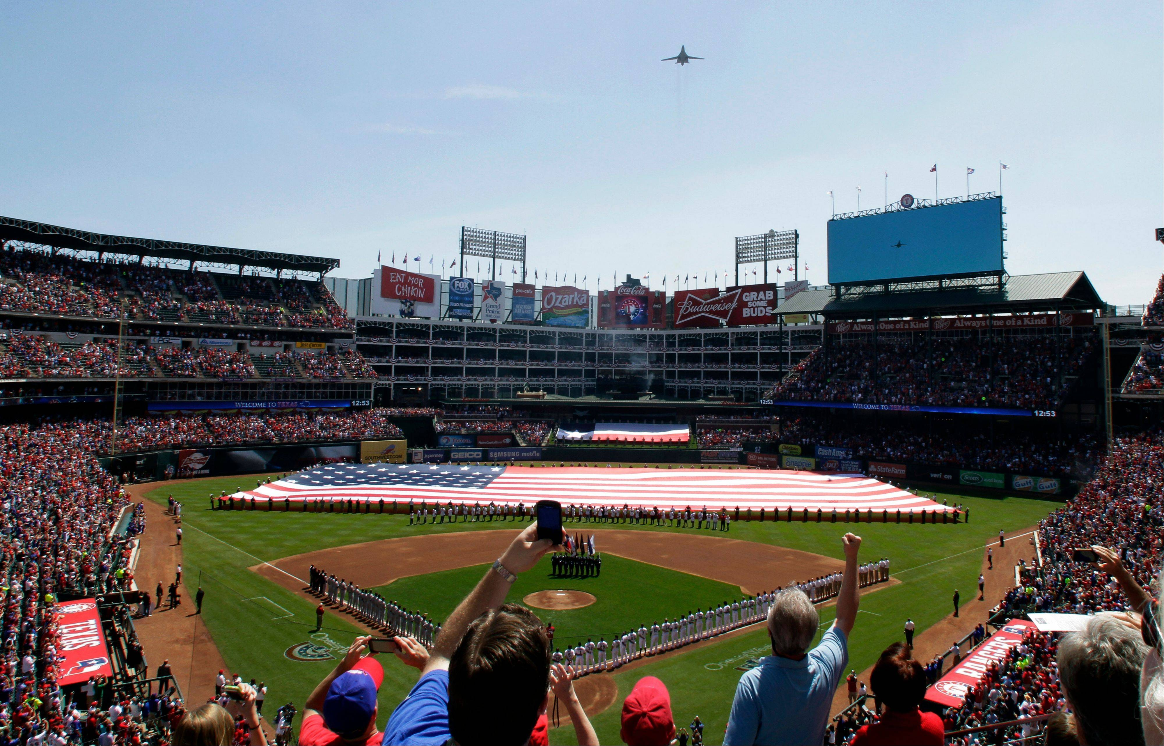 A B-1 Bombers from the 7th Bomb Wing of Dyess Air Force Base in Abilene, Texas flies over Rangers stadium before a baseball game between the Texas Rangers and the Chicago White Sox Friday, April 6, 2012 in Arlington, Texas.