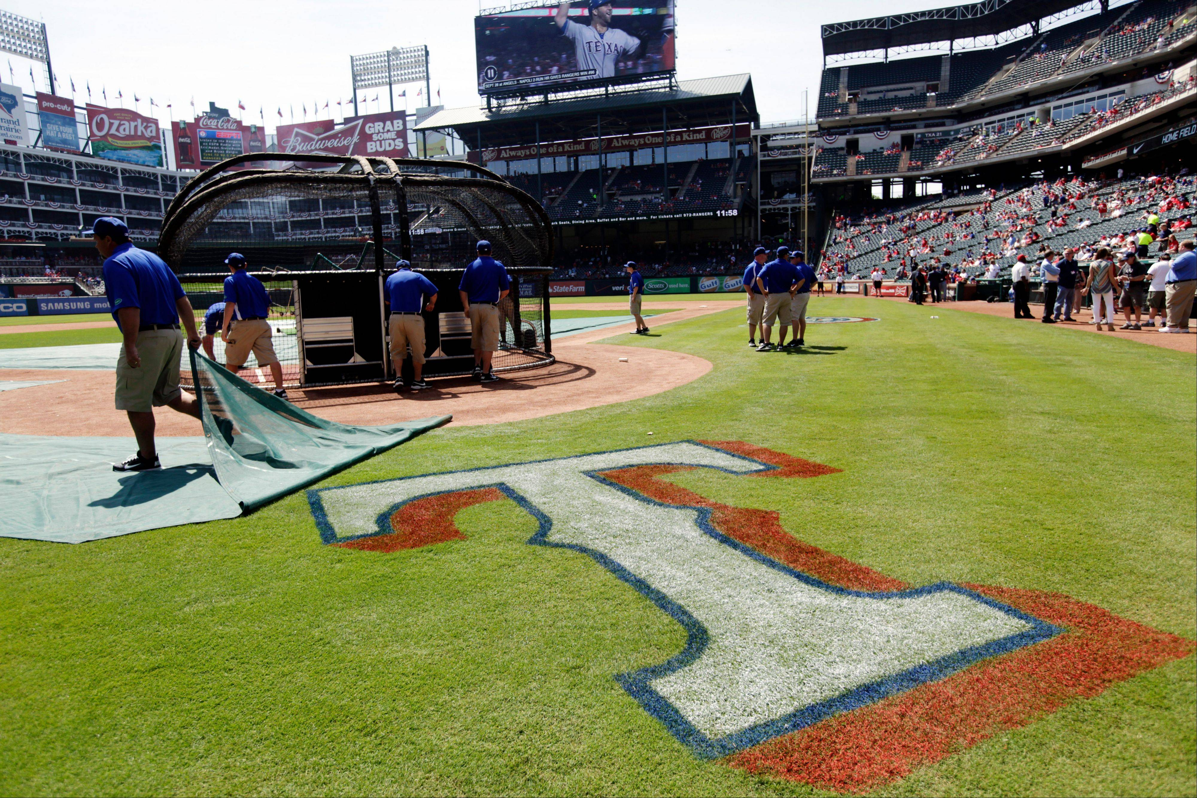 The Texas Rangers logo is uncovered before a baseball game against the Chicago White Sox Friday, April 6, 2012 in Arlington, Texas.