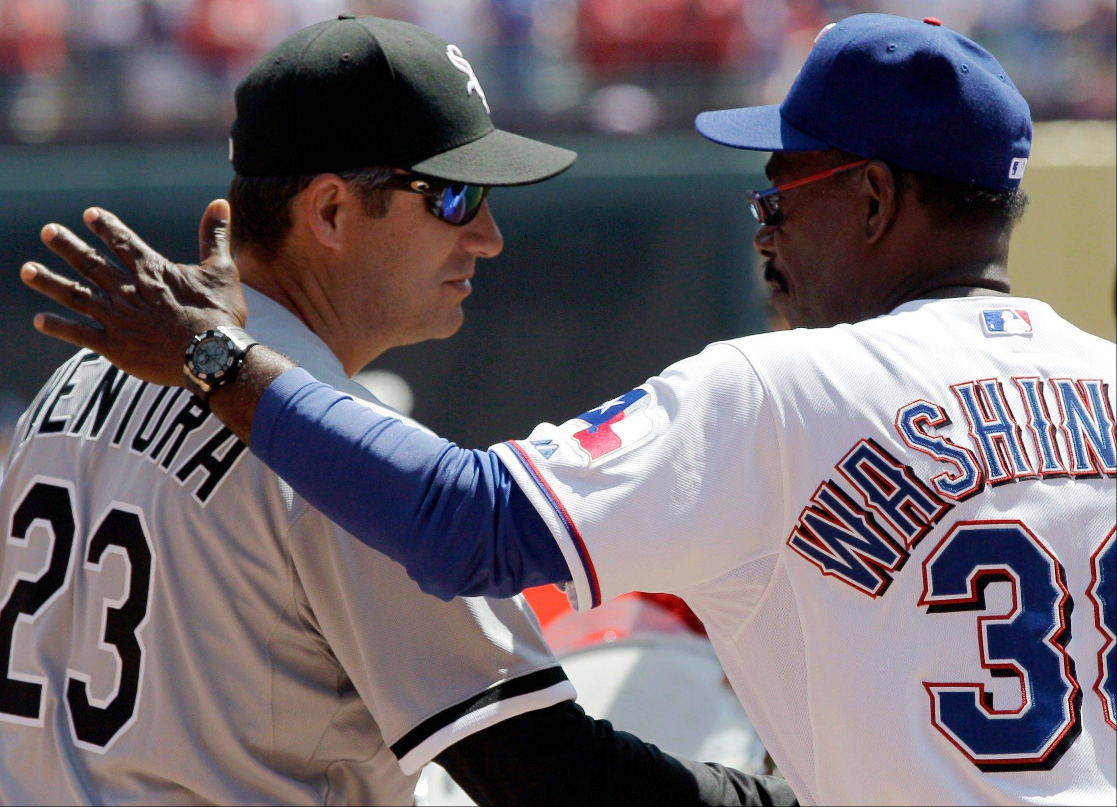 Chicago White Sox manager Robin Ventura (23) and Texas Rangers manager Ron Washington (38) greet before a baseball game Friday, April 6, 2012 in Arlington, Texas.