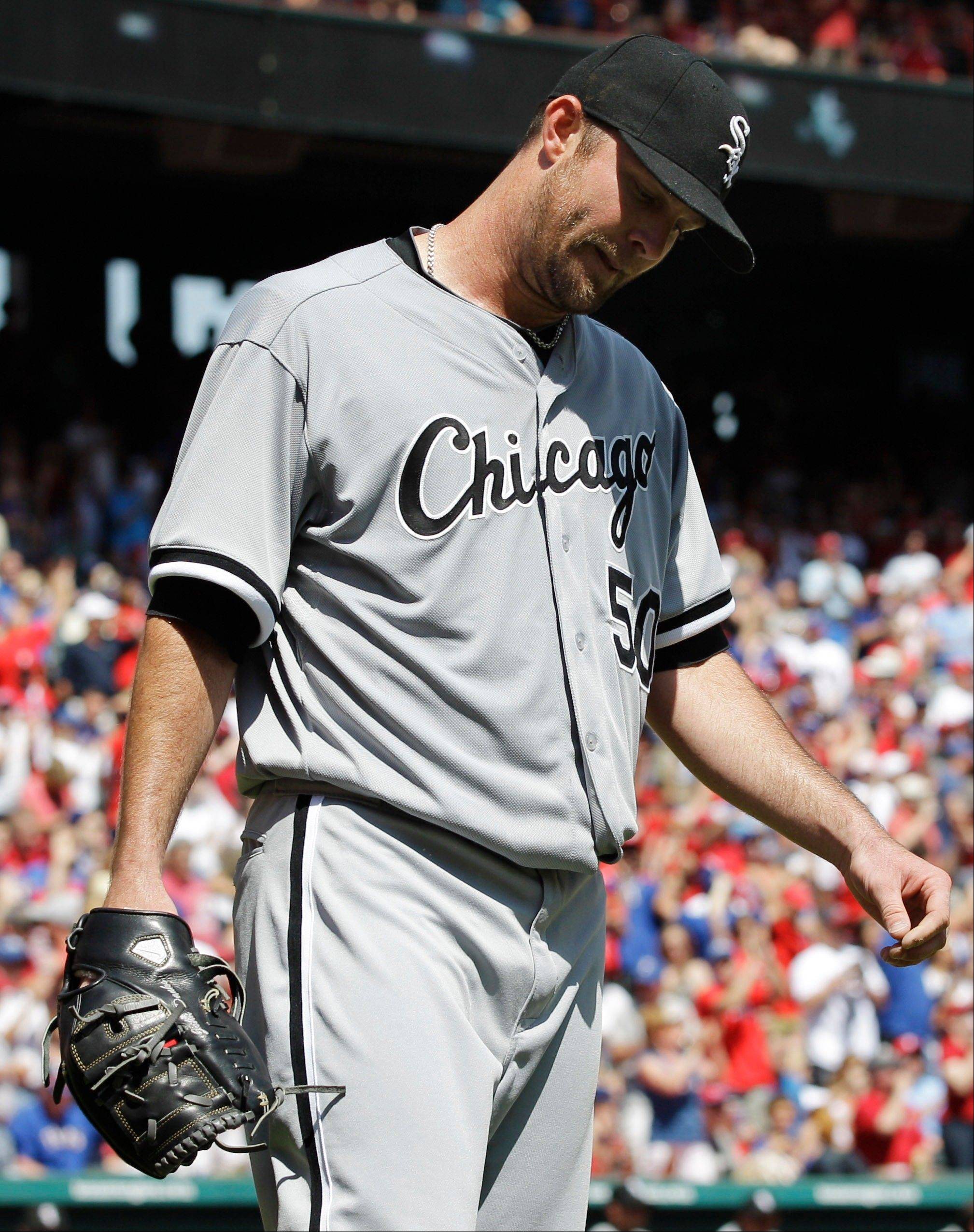 Chicago White Sox starting pitcher John Danks reacts after giving up an RBI-single to Texas Rangers' Michael Young during the sixth inning of a baseball game on Friday, April 6, 2012, in Arlington, Texas.