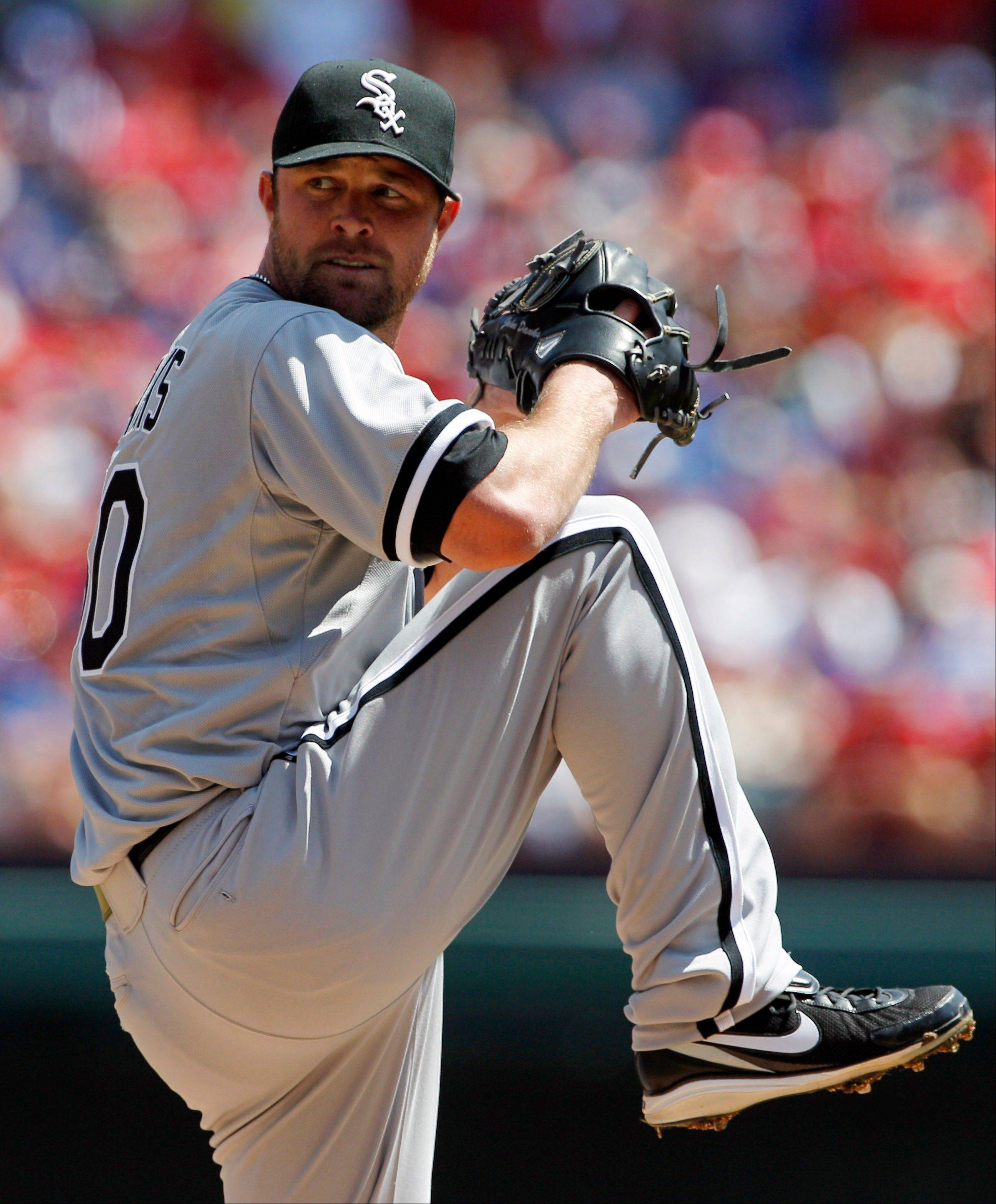 Chicago White Sox starting pitcher John Danks delivers the ball against the Texas Rangers during the first inning of a baseball game Friday, April 6, 2012 in Arlington, Texas.