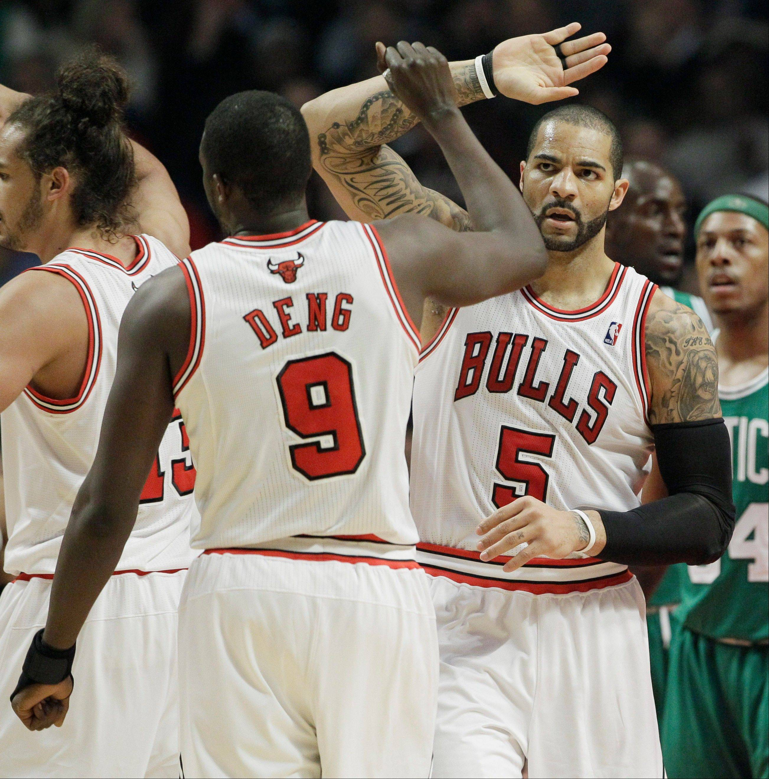 Bulls forward Carlos Boozer celebrates Thursday with forward Luol Deng after scoring a basket during the first half.