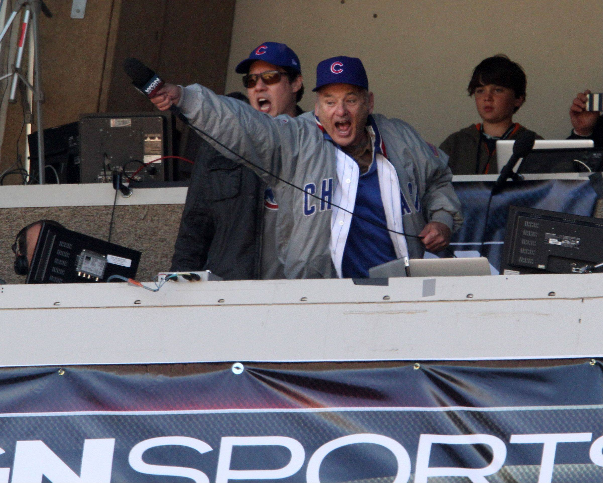 George LeClaire/gleclaire@dailyherald.comActor Bill Murray tries to fire the crowd up and get them to sing louder during the seventh-inning stretch at Wrigley Field.