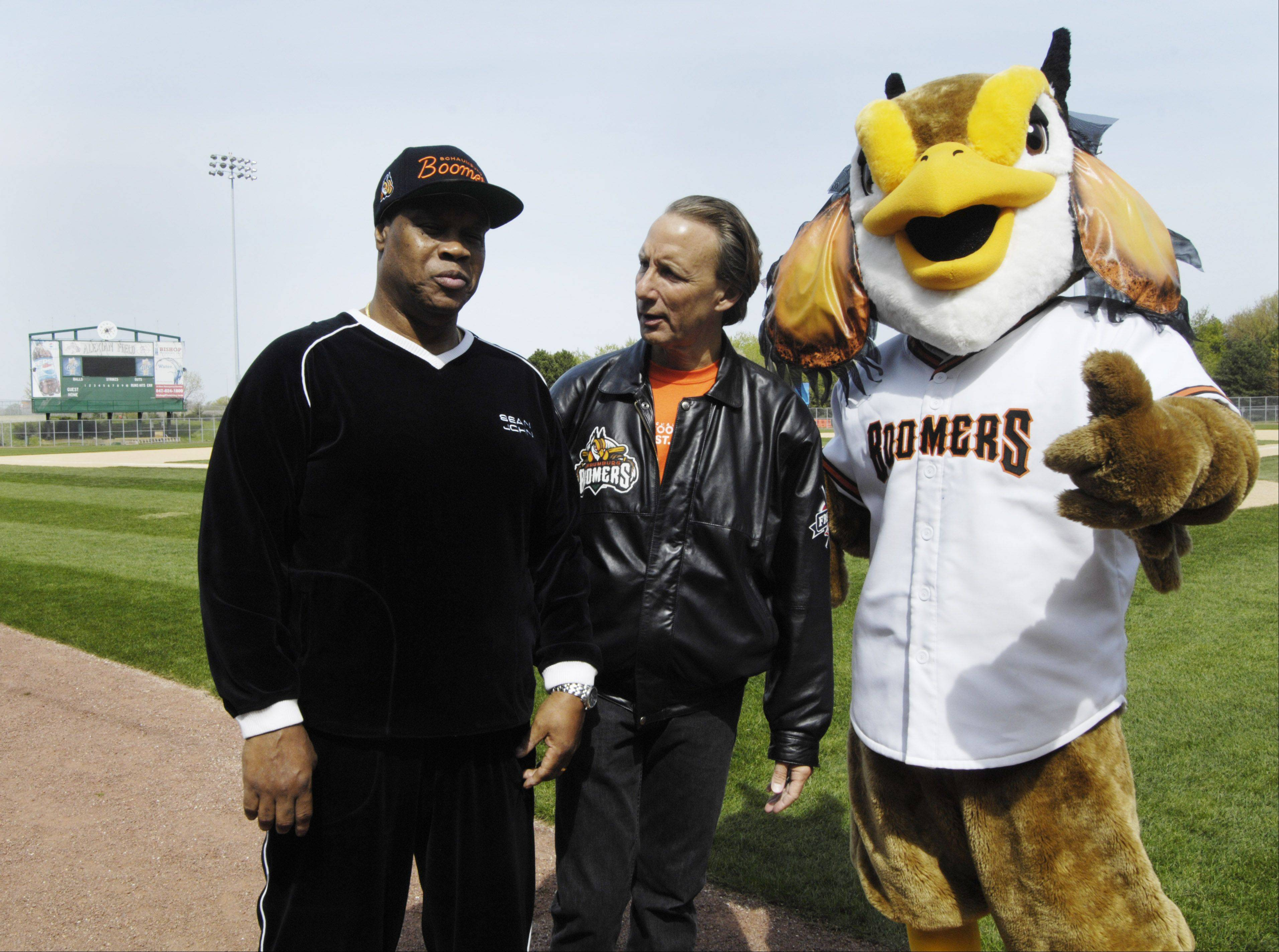 Former White Sox player Carlos May, left, stands with the team's owner Pat Salvi, and its mascot following his introduction as a coach during the Schaumburg Boomers baseball team open house Saturday.