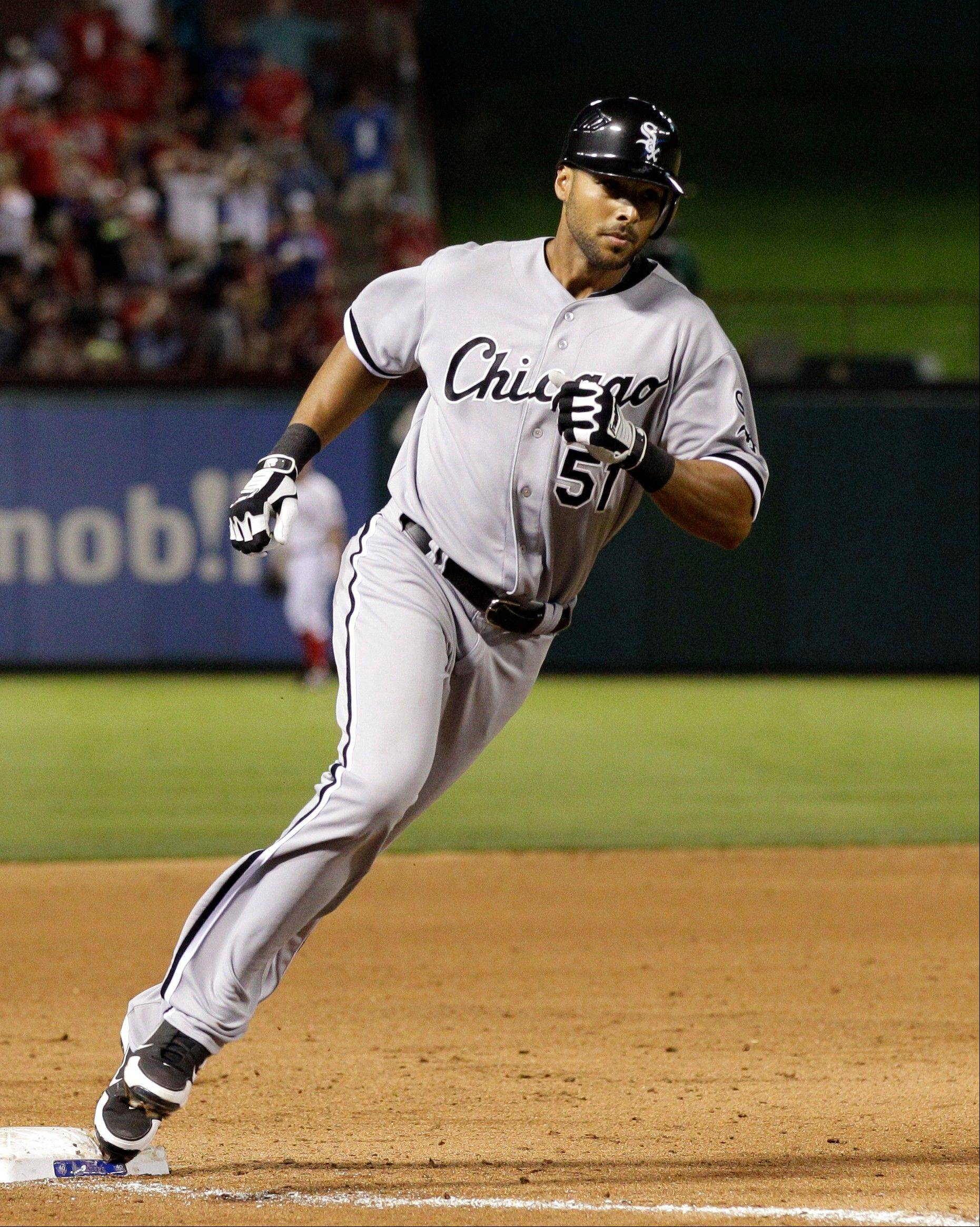 Alex Rios rounds third after hitting his game-winning home run in the ninth inning Saturday at Texas.