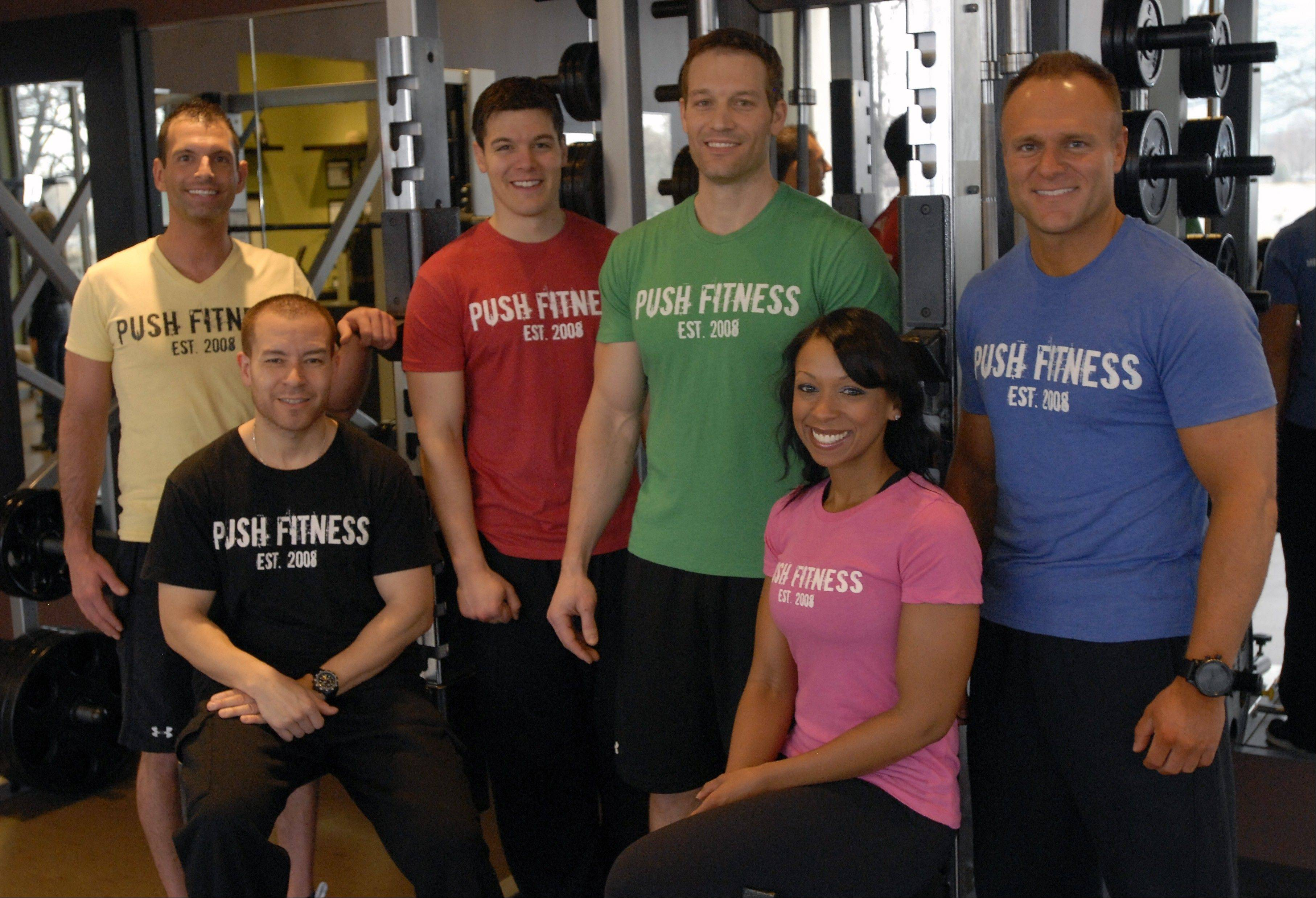 These Push Fitness trainers -- Steve Amsden, left, Tony Figueroa, Wade Merrill, Joshua Steckler, Michelle Amsden and Mark Trapp are responsible for motivating the Fittest Loser contestants all the way through the 12-week competition.