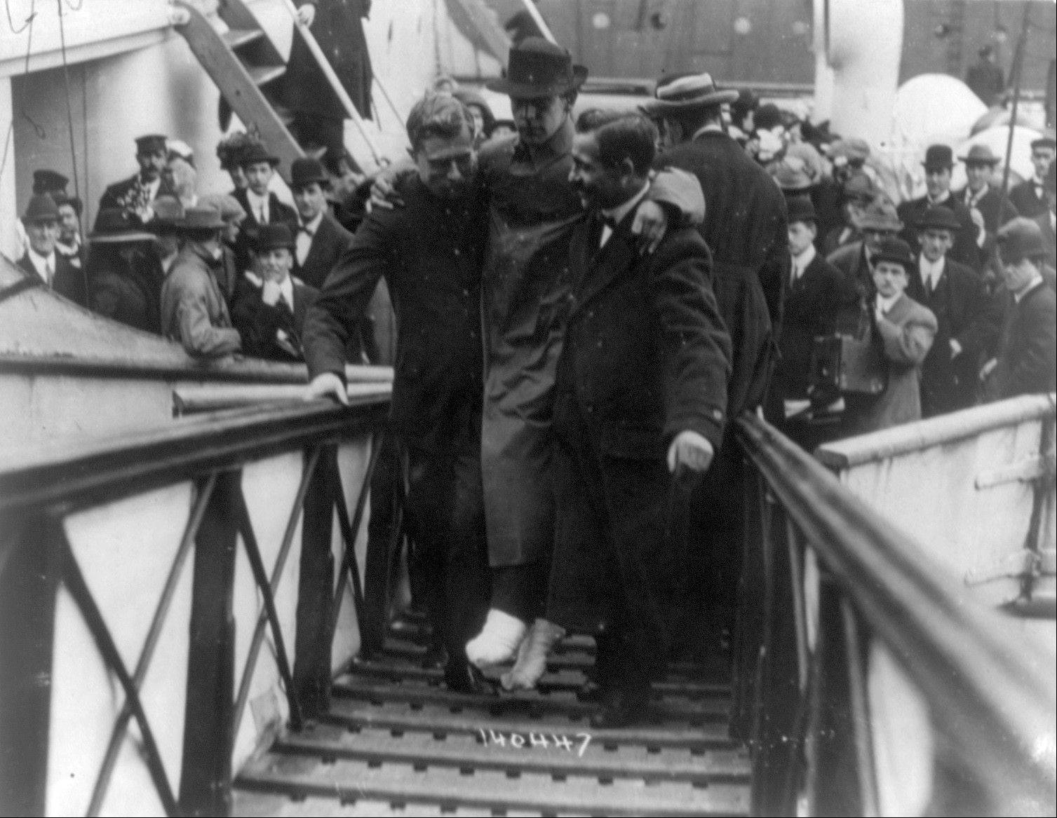 "In this 1912 photo made available by the Library of Congress, Harold Bride, surviving wireless operator of the Titanic, with feet bandaged, is carried up the ramp of a ship. April 15, 2012 is the 100th anniversary of the sinking of the Titanic, just five days after it left Southampton on its maiden voyage to New York. It was a news story that would change the news. From the moment that a brief Associated Press dispatch relayed the wireless distress call _ ""Titanic ... reported having struck an iceberg. The steamer said that immediate assistance was required"" _ reporters and editors scrambled. In ways that seem familiar today, they adapted a dawning newsgathering technology and organized saturation coverage and managed to cover what one authority calls ""the first really, truly international news event where anyone anywhere in the world could pick up a newspaper and read about it."""