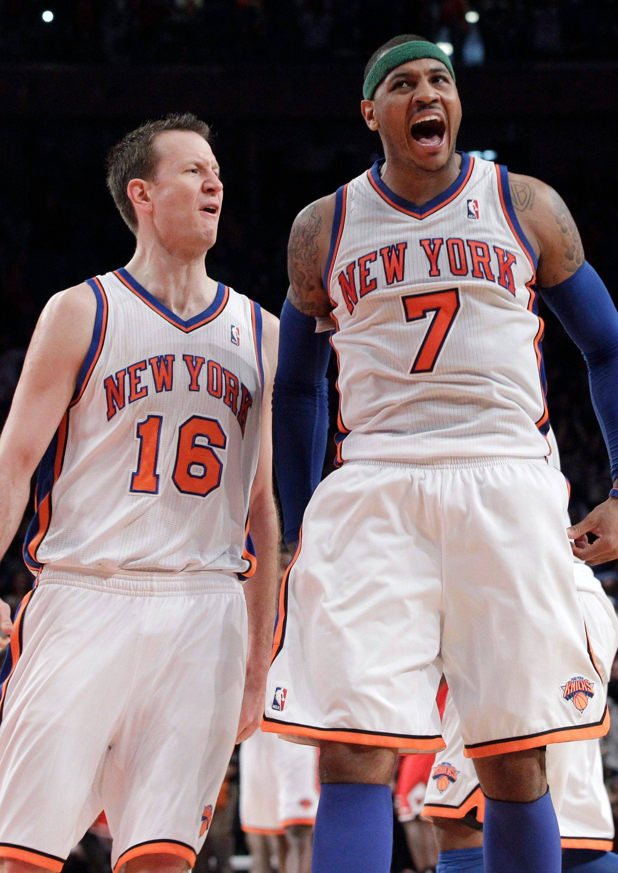 The Knicks' Carmelo Anthony (7) celebrates with Steve Novak after hitting a 3-point shot in the closing seconds of overtime Sunday to defeat the Bulls.