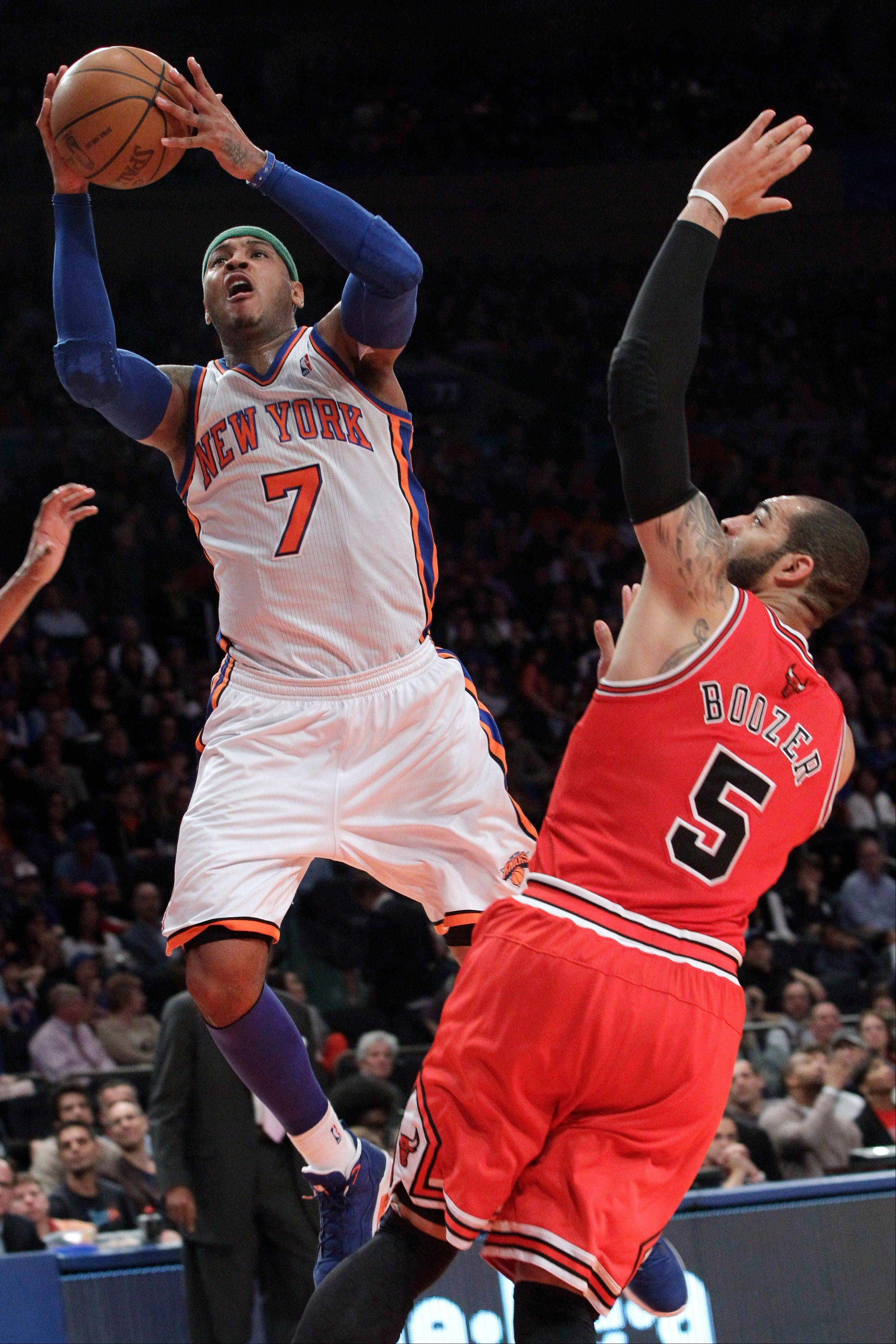 New York Knicks forward Carmelo Anthony goes to the basket past the Bulls' Carlos Boozer Sunday during the first half. Anthony scored 43 points in the Knicks' win.