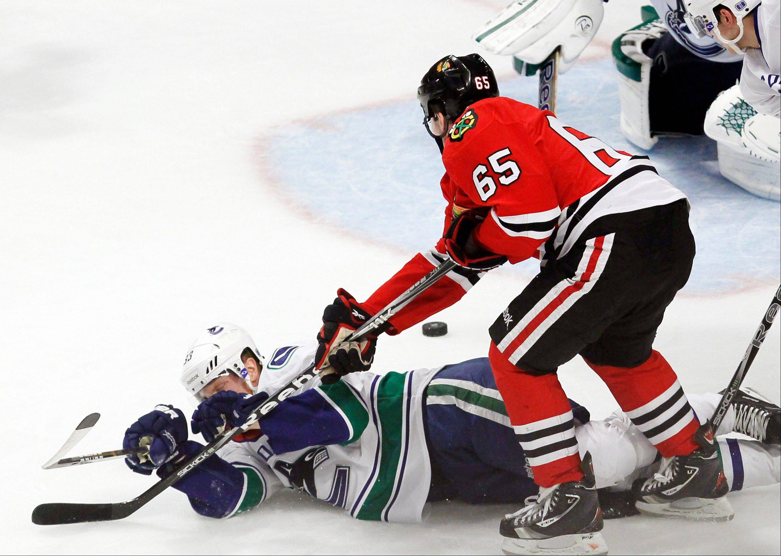 Vancouver Canucks center Henrik Sedin tried everything to stop Blackhawks winger Andrew Shaw when they met on the ice on March 21.