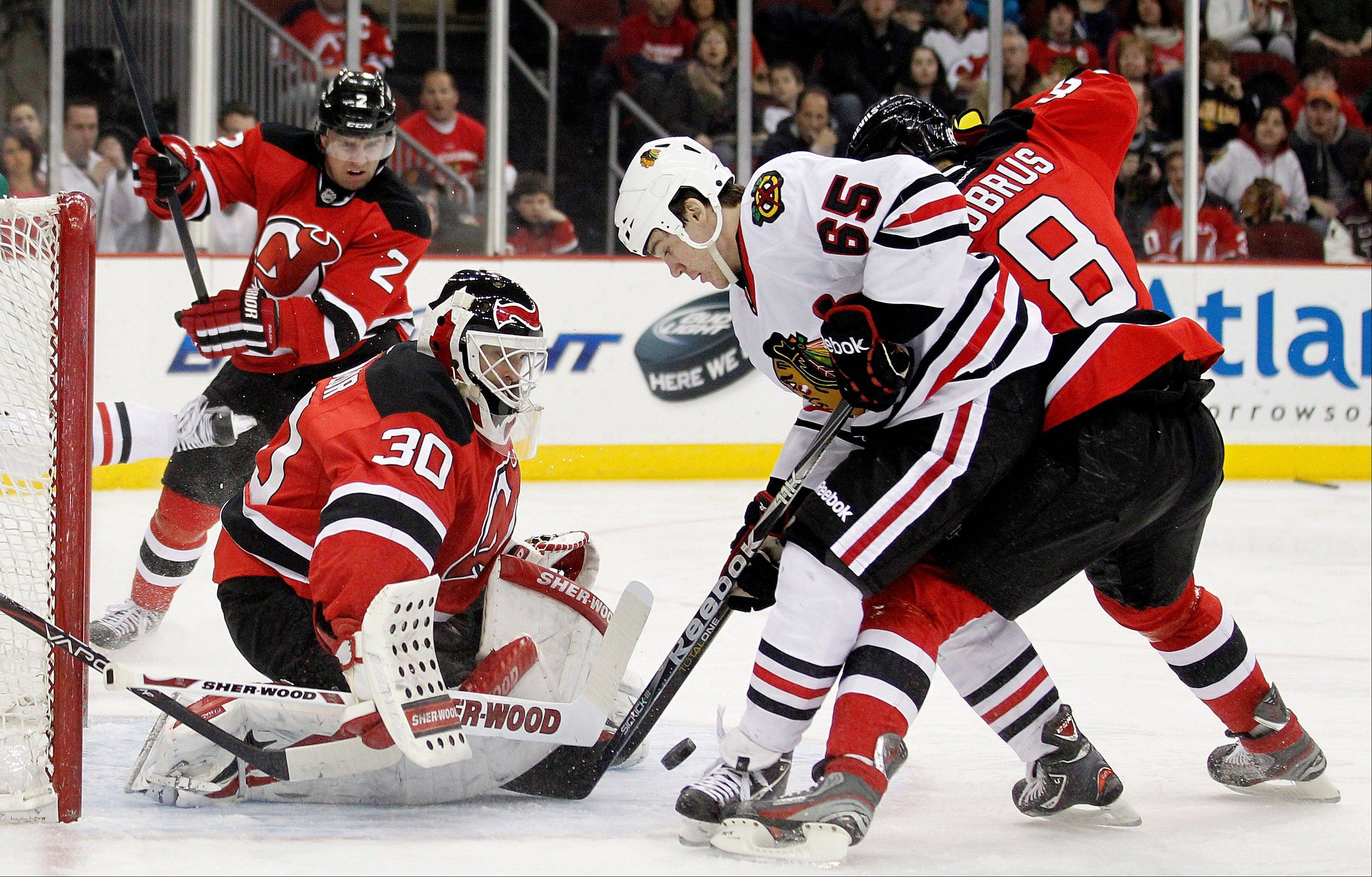 Only 175 pounds, Andrew Shaw (65) finds a way to get to the net against the New Jersey Devils on March 27.