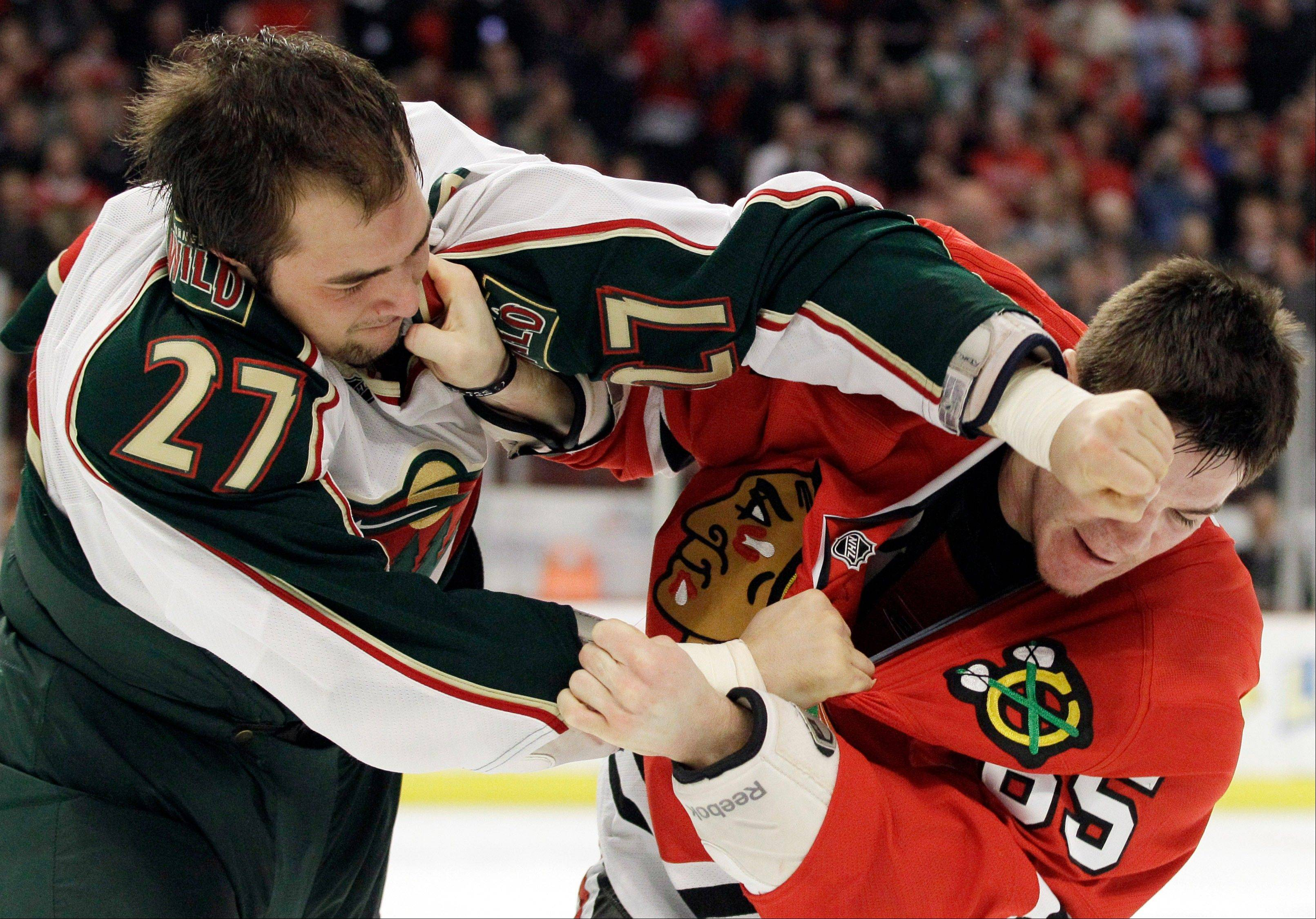As Minnesota Wild's Corey Almond learns, Andrew Shaw of the Blackhawks doesn't back down from a confrontation.