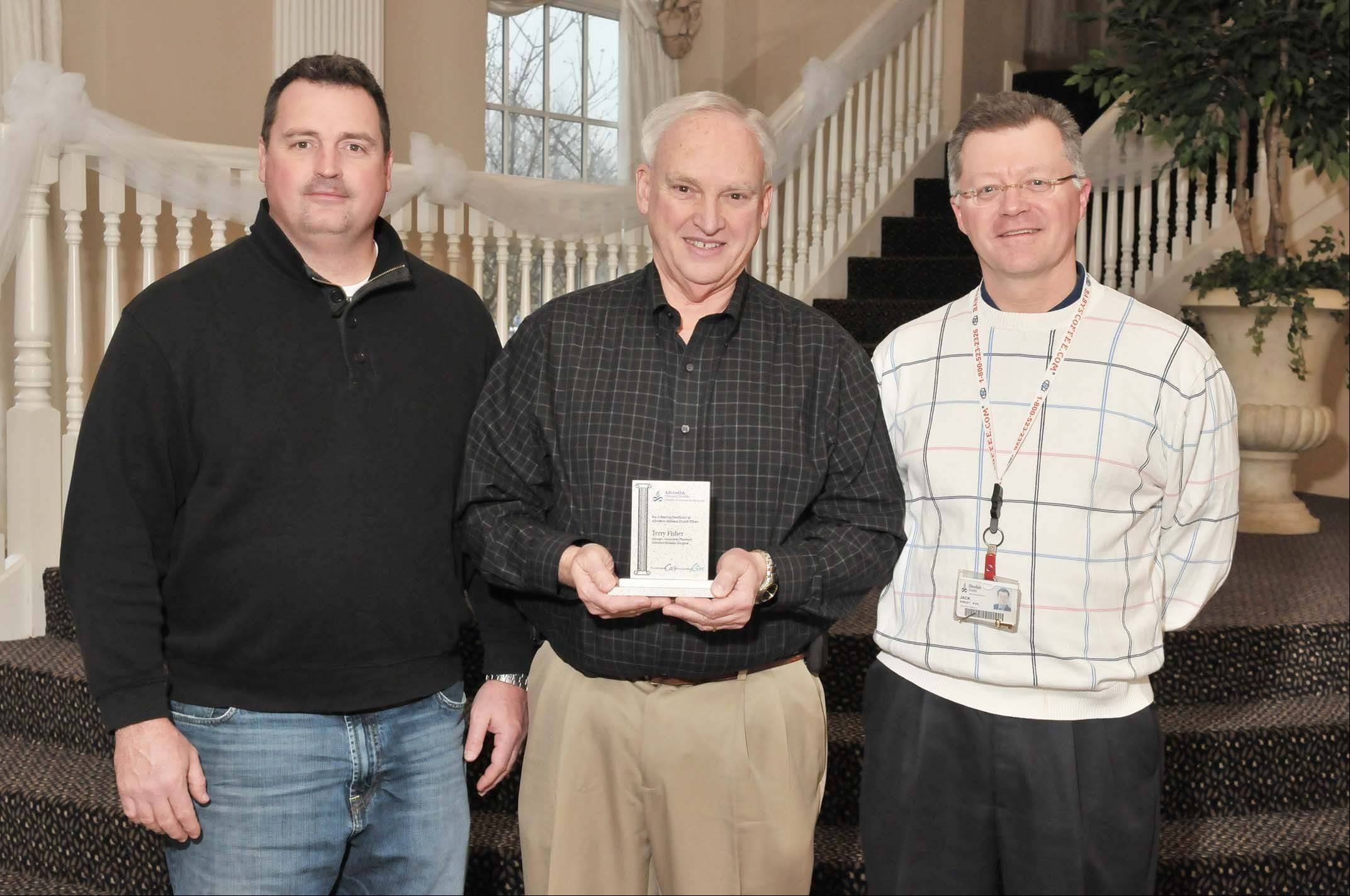 Terry Fisher, center, is pictured with, from left, Frank Johnson, interim chief operating officer of Adventist Hinsdale Hospital, and Jack Durley, director of the pharmacy at Adventist Hinsdale Hospital.