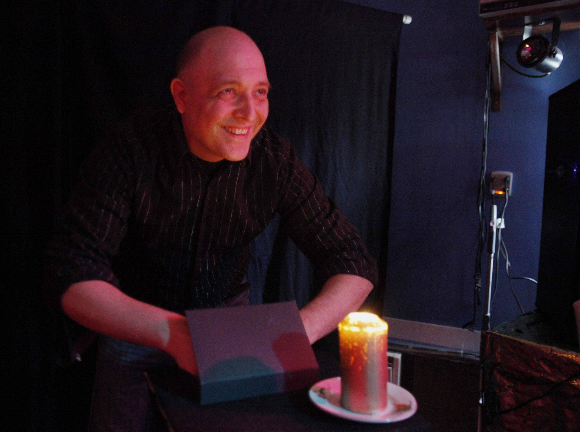 Magician Mark Presley Hawkins grins after showing off his 'Butterfly in a Box' trick, which he hopes to unveil to audiences later this year.